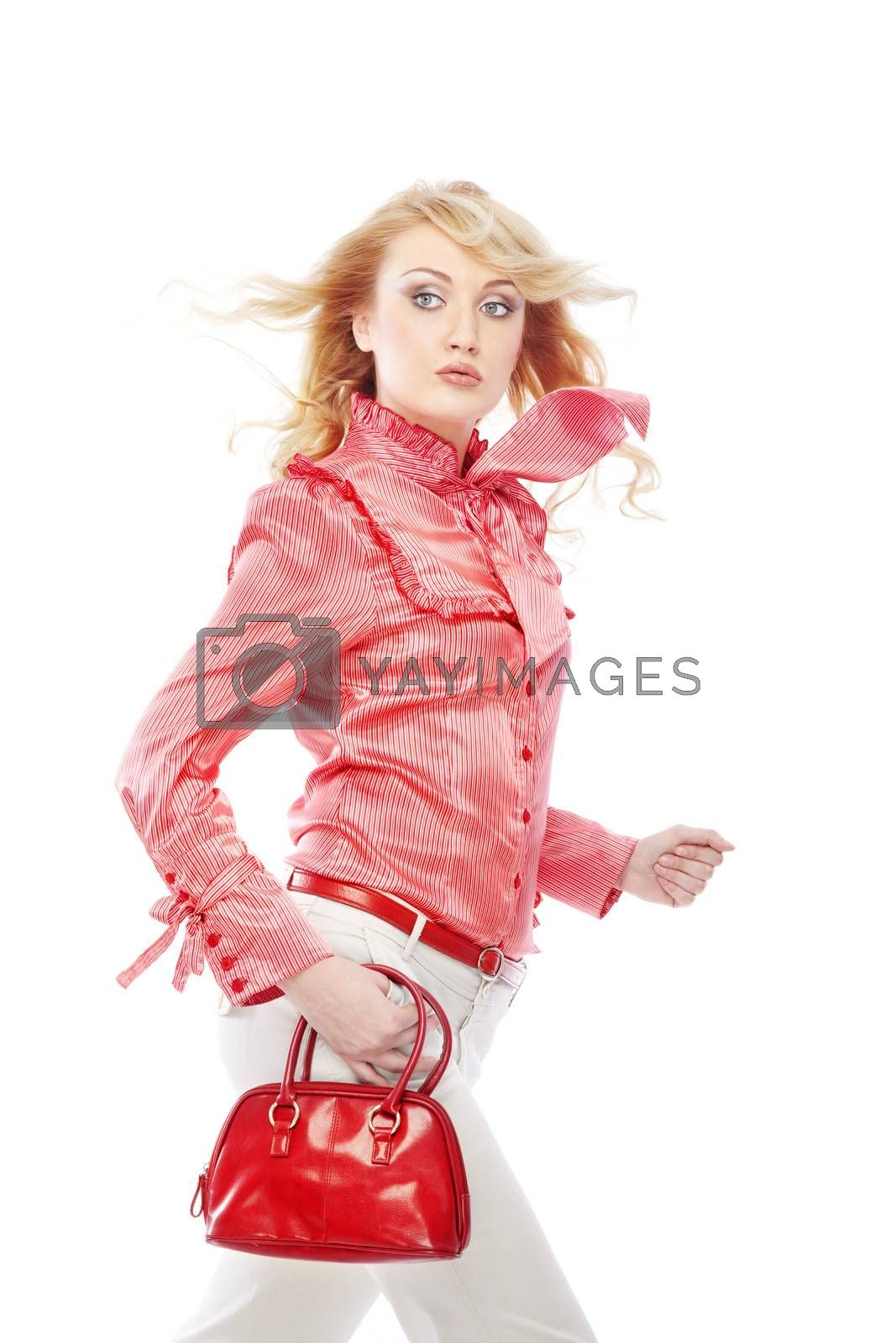 Moving lady in stylish clothes with red bag