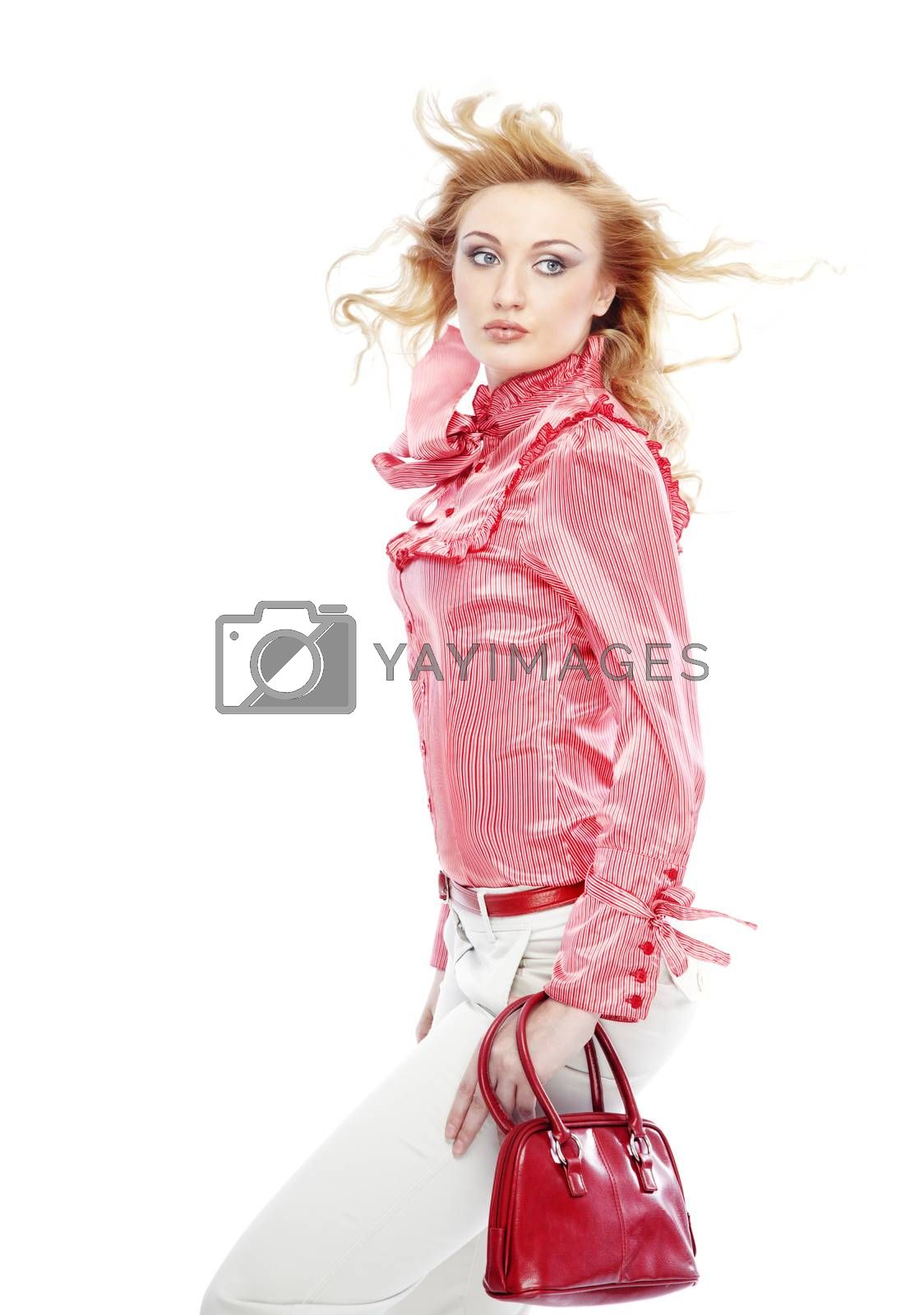Attractive lady in stylish clothes with red bag and perfect makeup