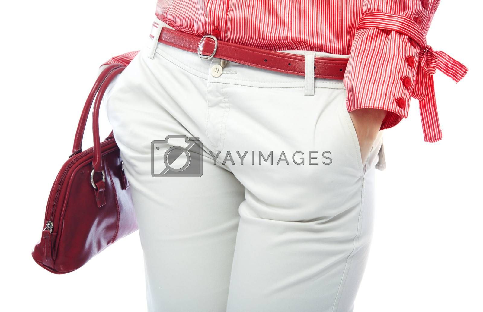Body part of stylish lady in modern clothes with fashionable bag