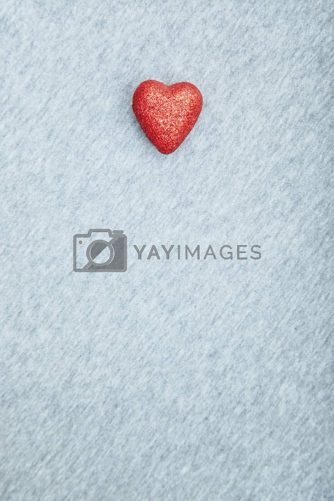 Red heart of love on a textured background