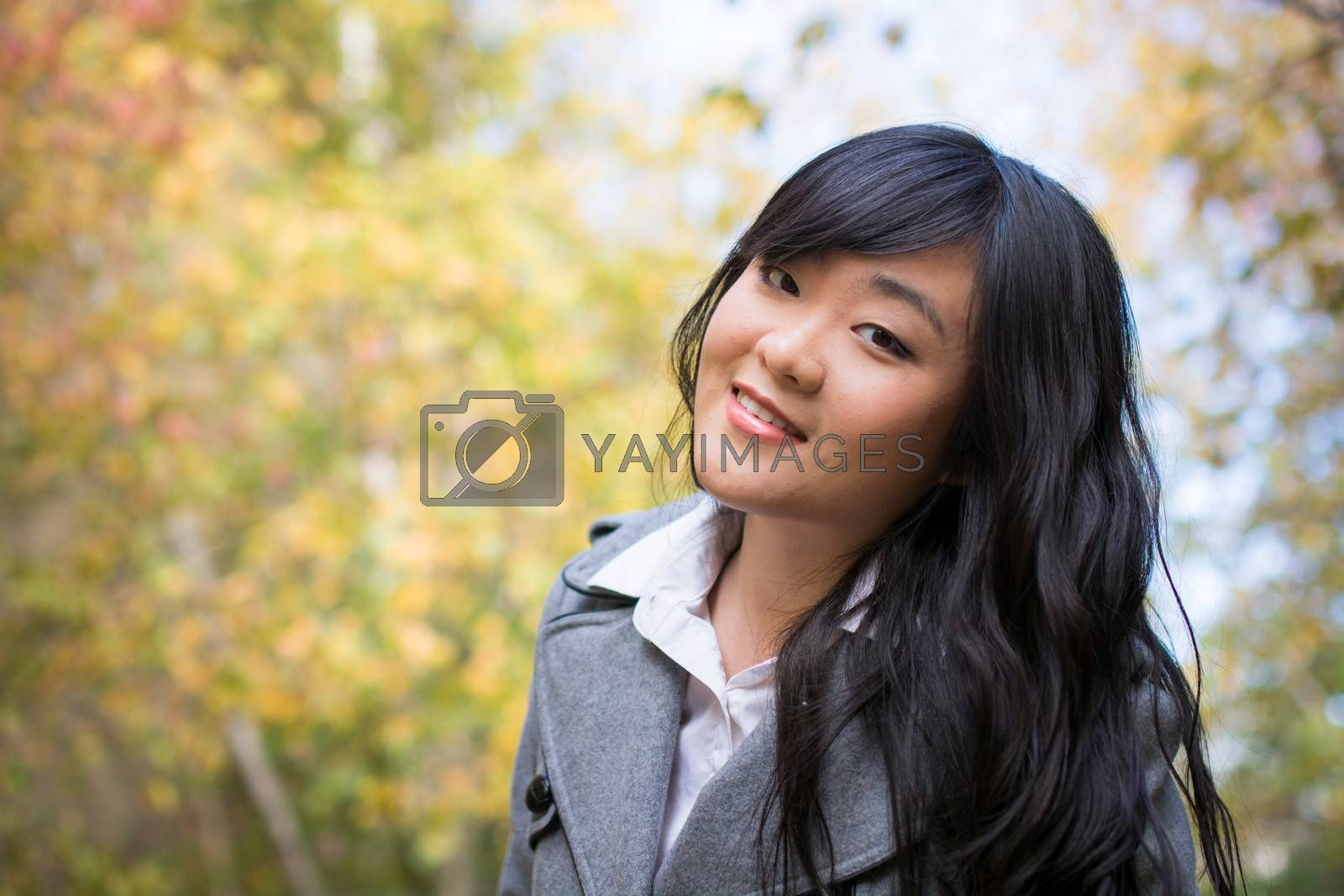 Portrait of young beautiful girl bending forward and tilting her head