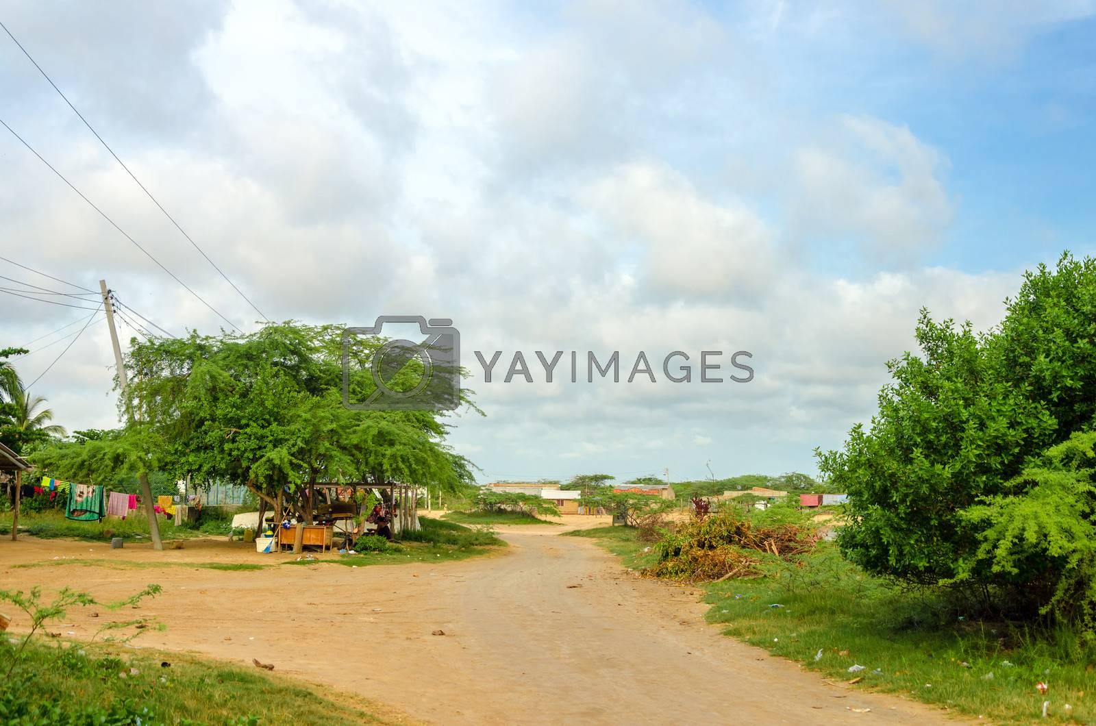 Dirt road passing through a rural village in La Guajira, Colombia