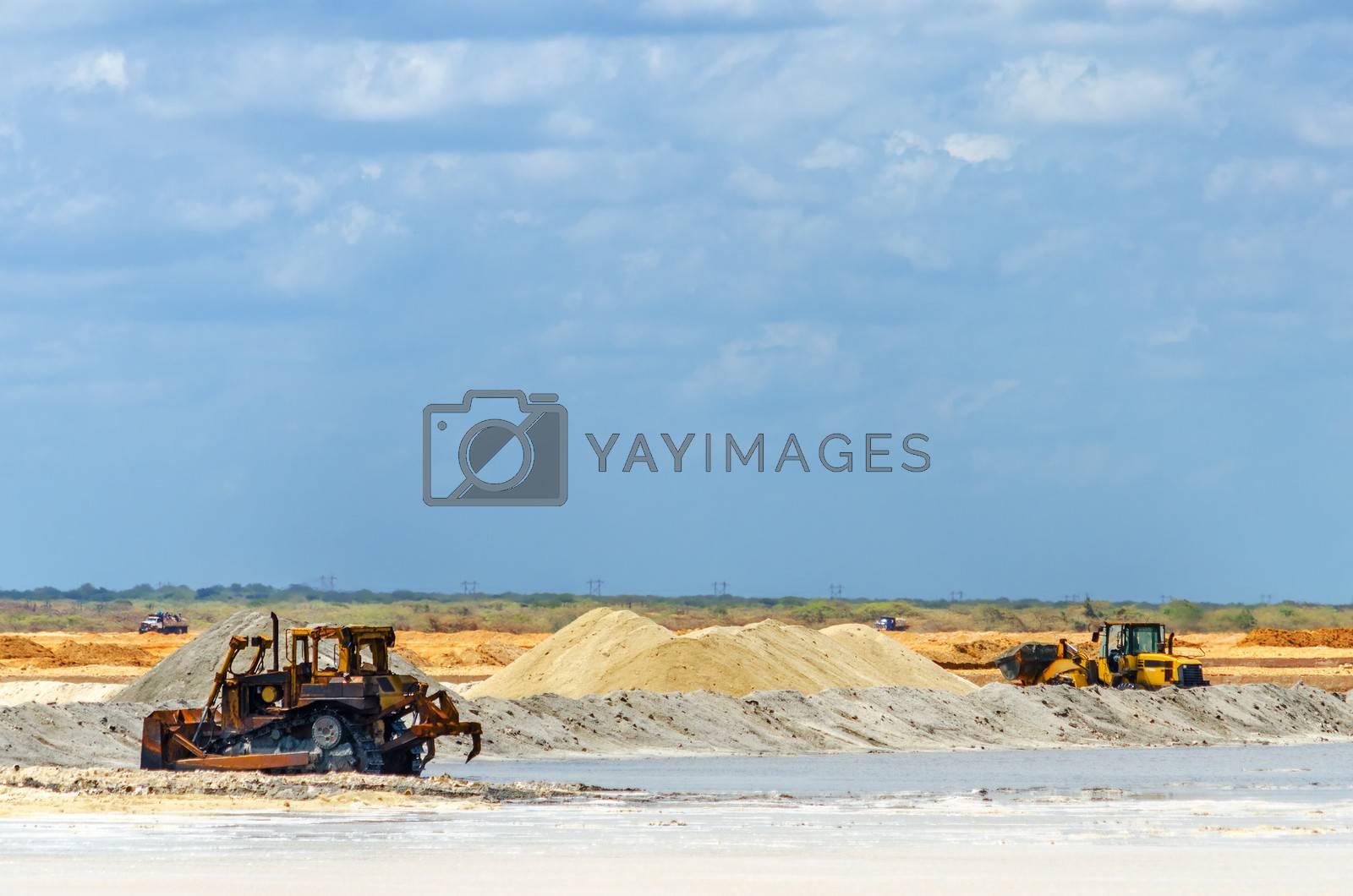 Heavy machinery gathering salt in Manaure in La Guajira, Colombia