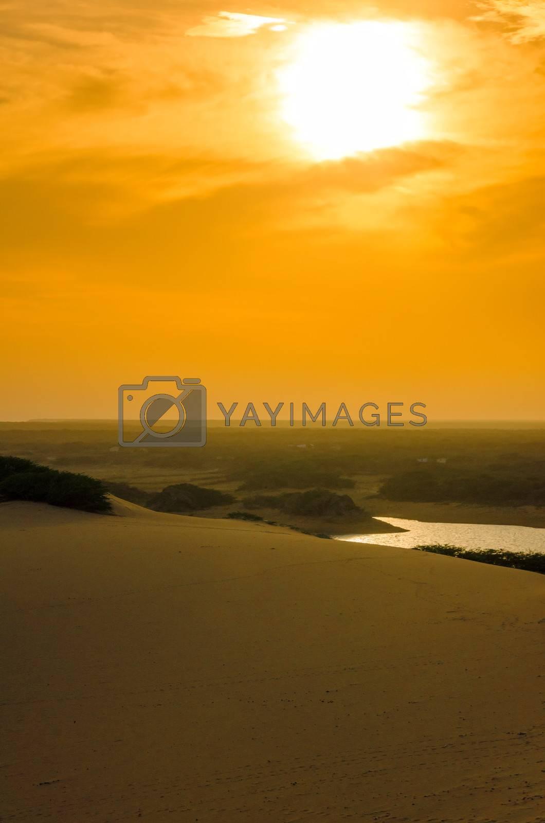 Bright orange sunset over a sand dune in La Guajira, Colombia