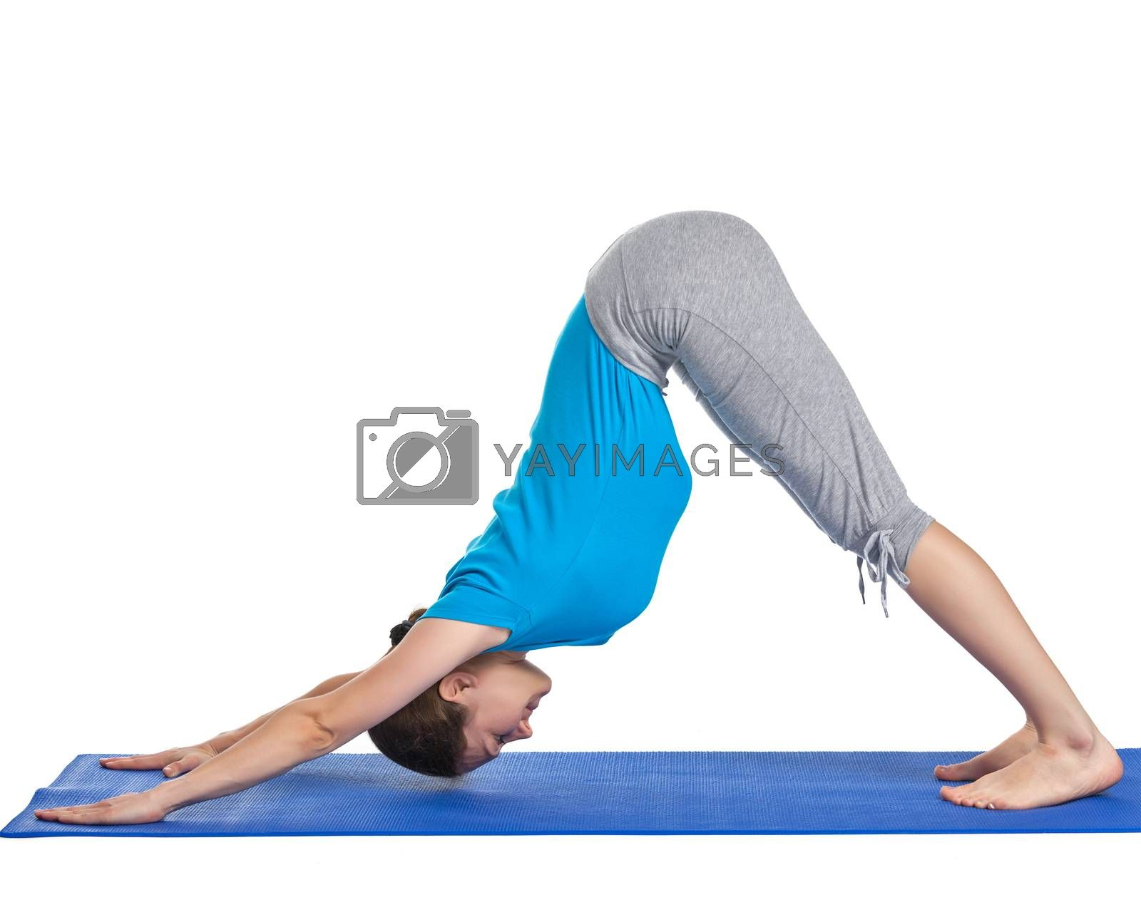Yoga - young beautiful woman yoga instructor doing downward facing dog pose (adho mukha svanasana) exercise isolated on white background