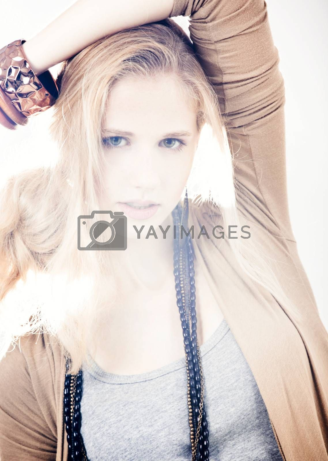 Beautiful fashion woman posing over a white background