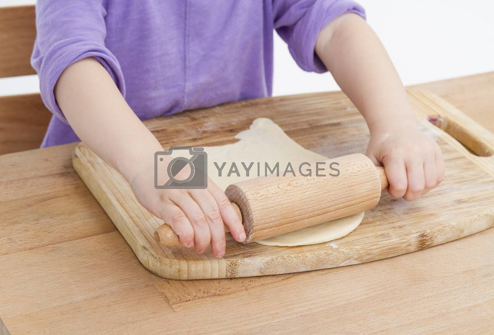 Royalty free image of rolling out dough for pizza by gewoldi