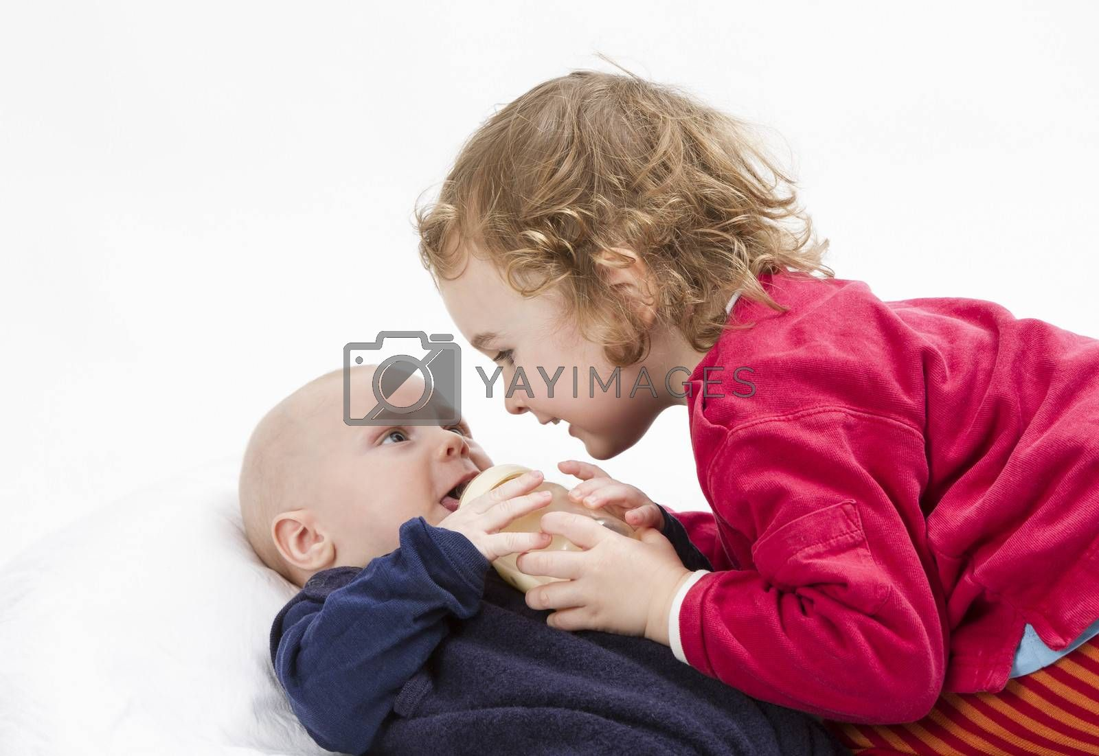 Royalty free image of baby boy with older sister by gewoldi