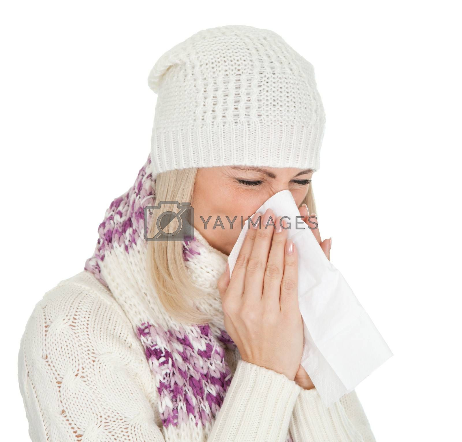 Woman in warm winter clothing sneezing from cold. Isolated on white