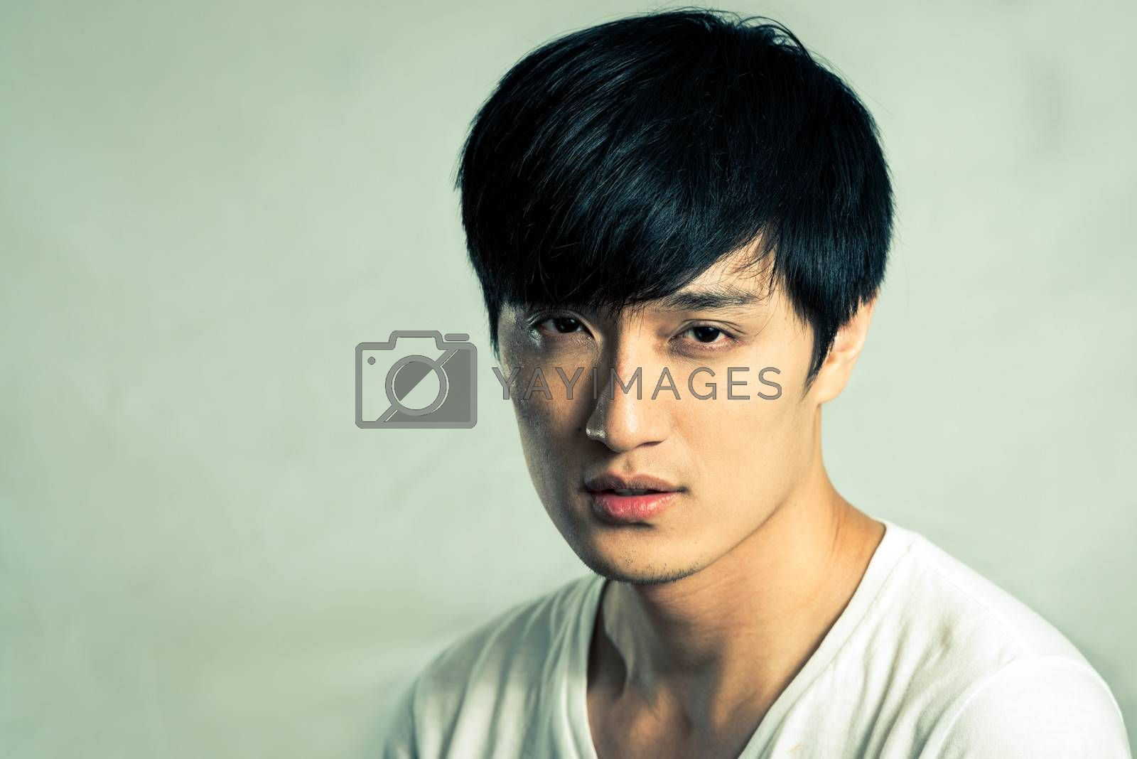 Young male model posing for fashion shot, with fashion tone and background
