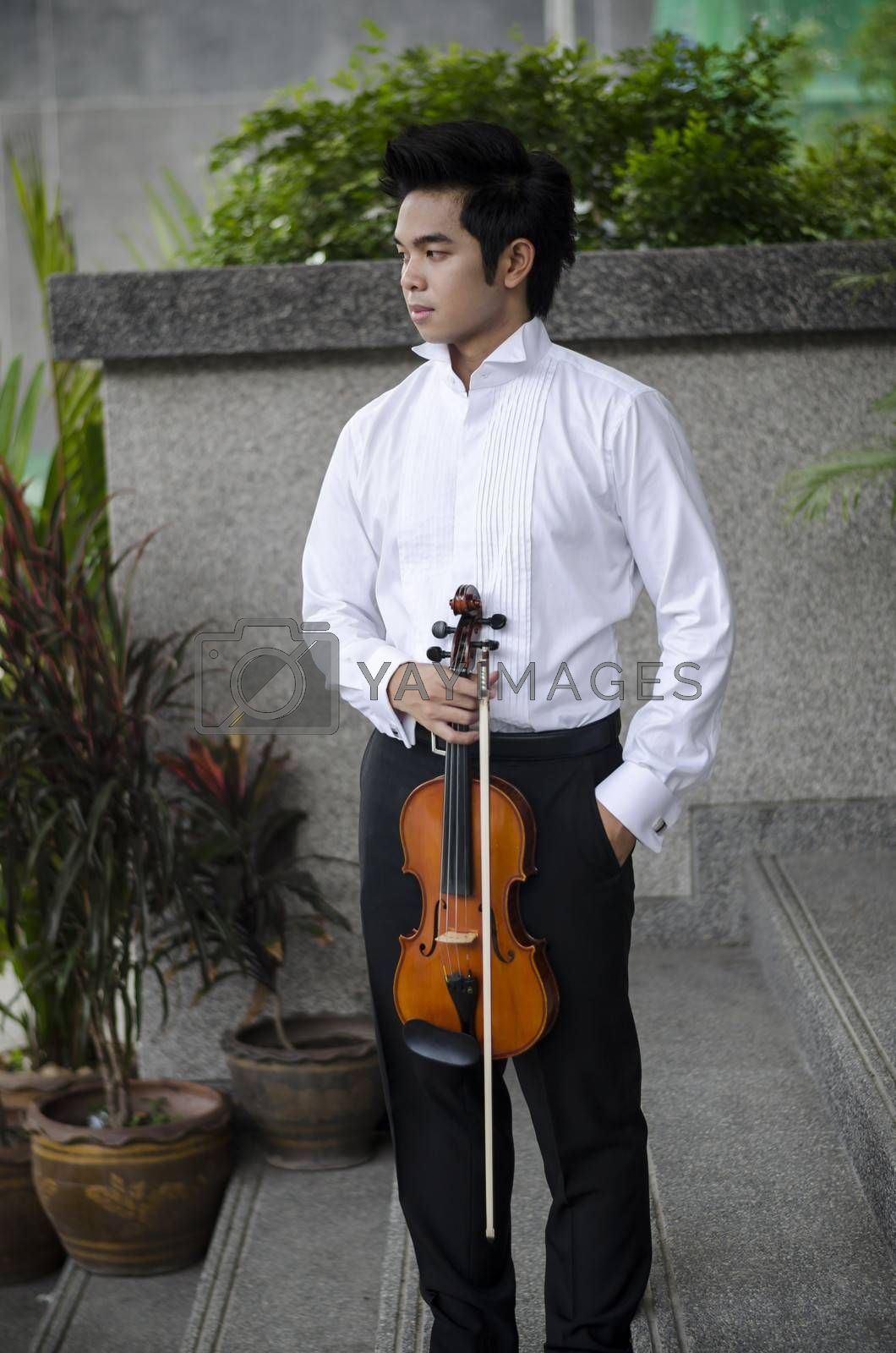 Thailand asia man with his violin he is a soloist