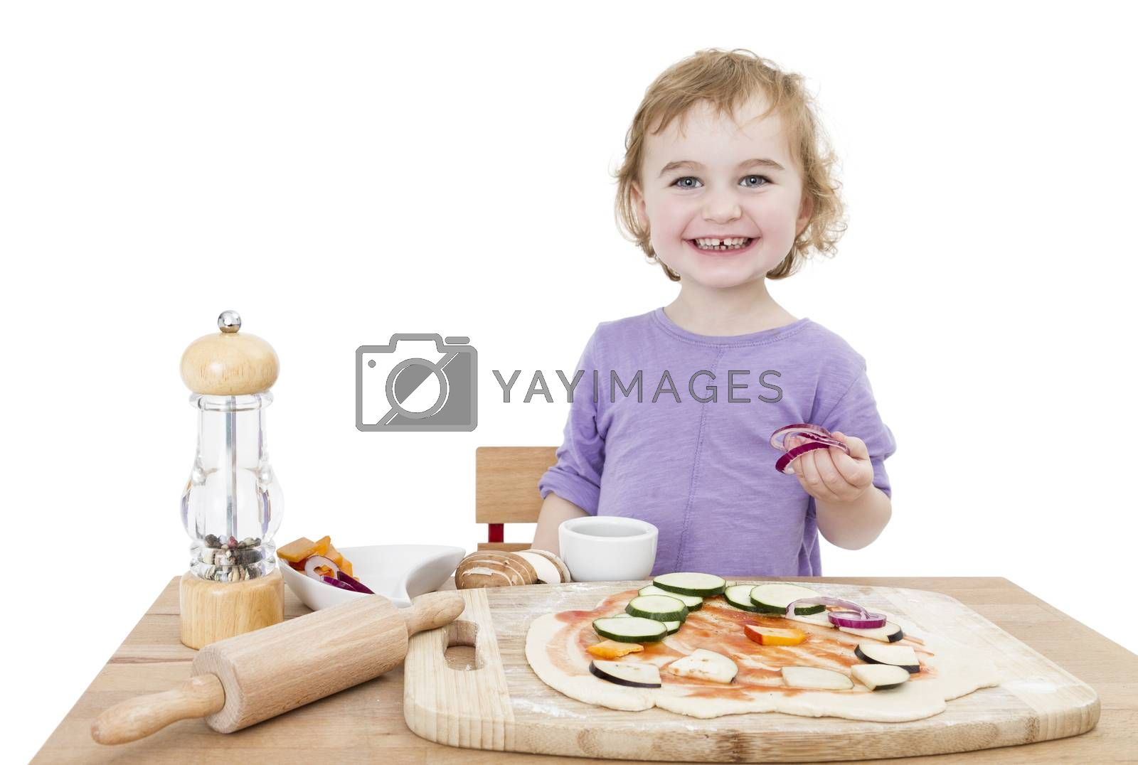 Royalty free image of happy child making pizza by gewoldi