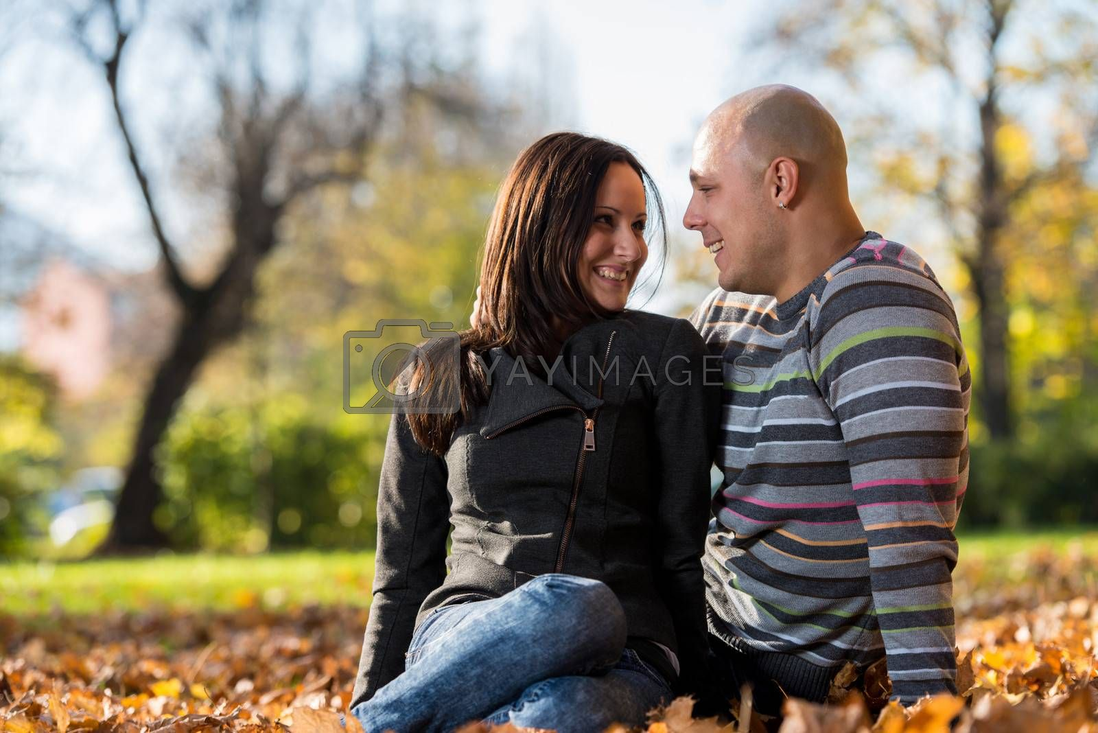Couple Lying Together At The Park