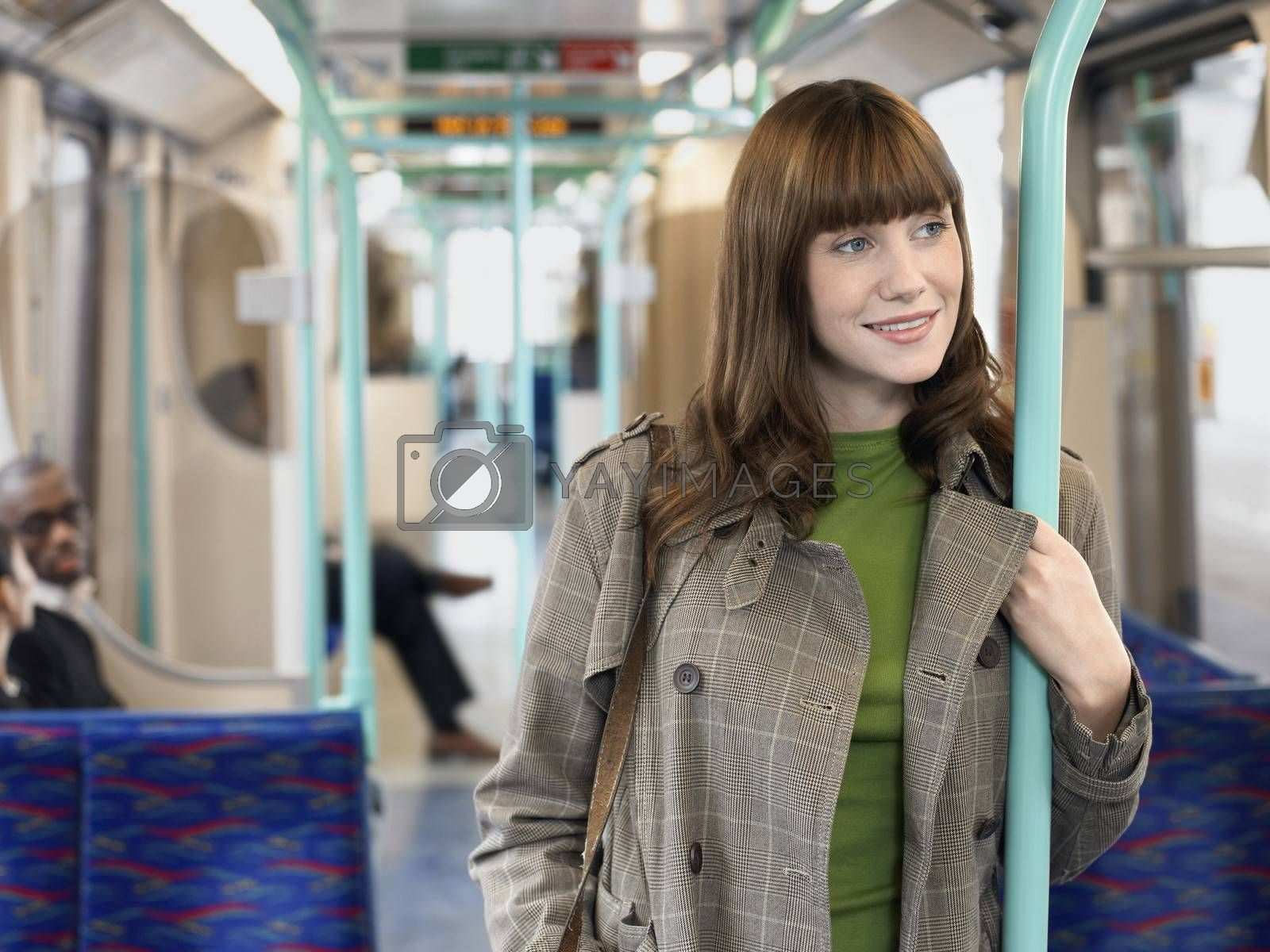 Smiling Woman Holding Bar In Commuter Train