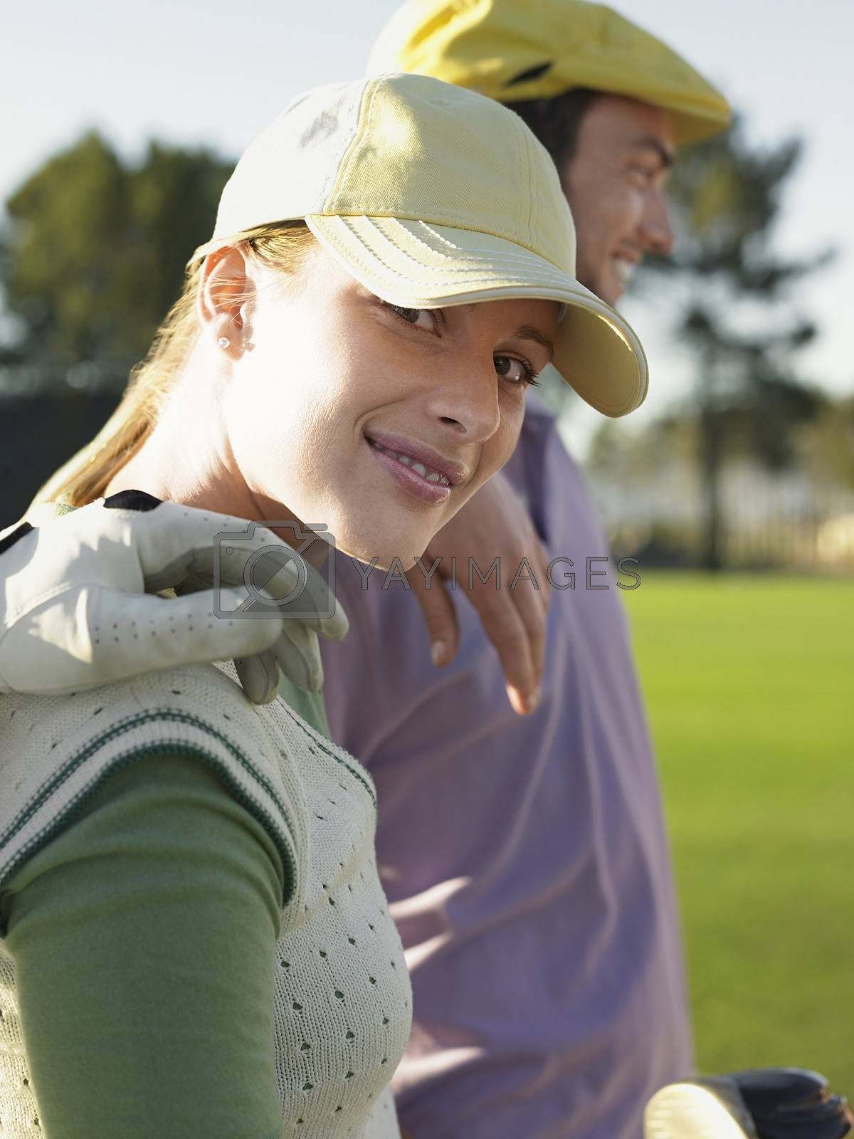 Female Golfer With Friends On Golf Course