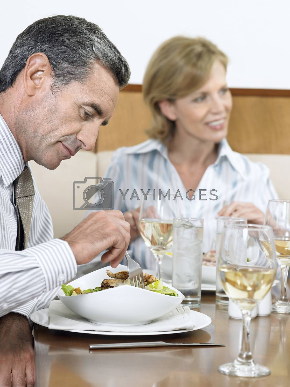 Businesspeople Having Food At Restaurant
