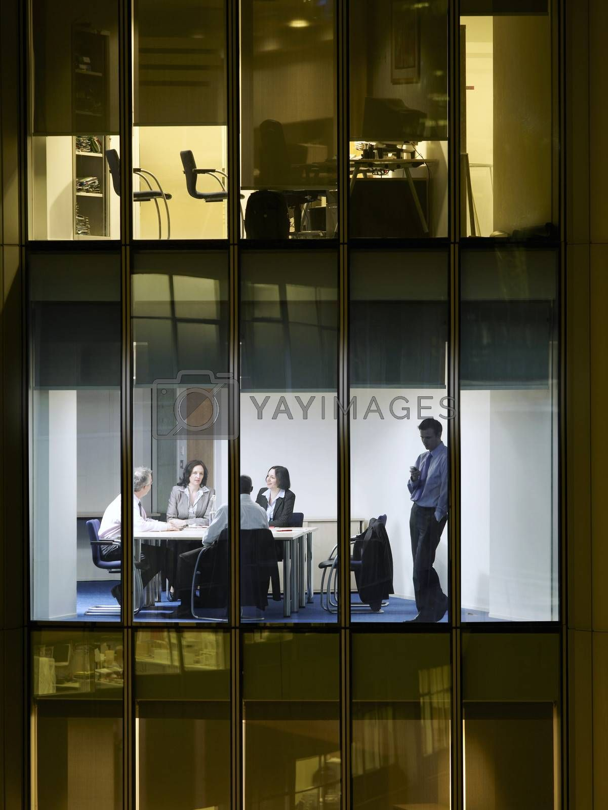 Group of business people at meeting in office view from building exterior by moodboard