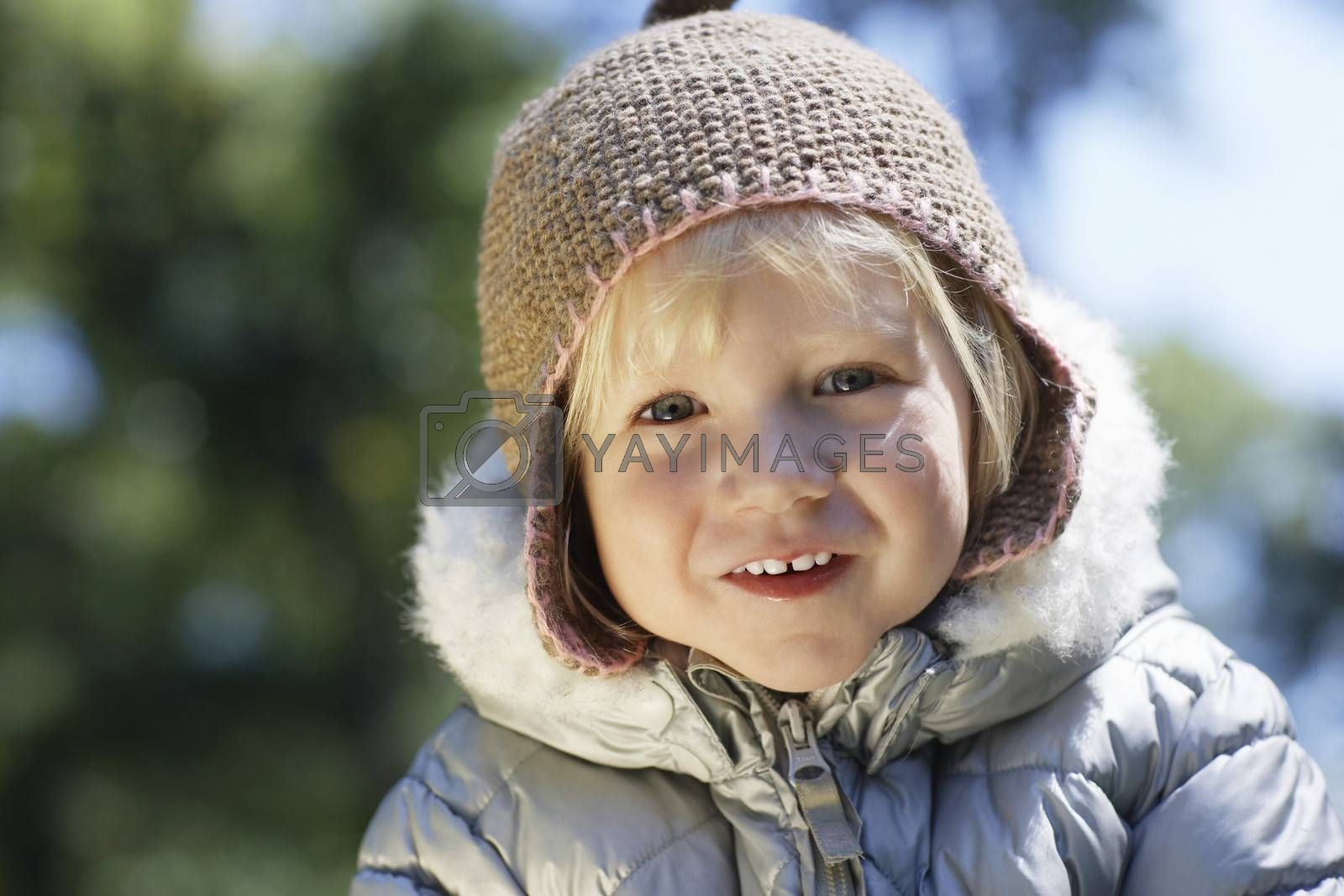 Royalty free image of Portrait of young girl (3-4) in winter clothes outdoors by moodboard
