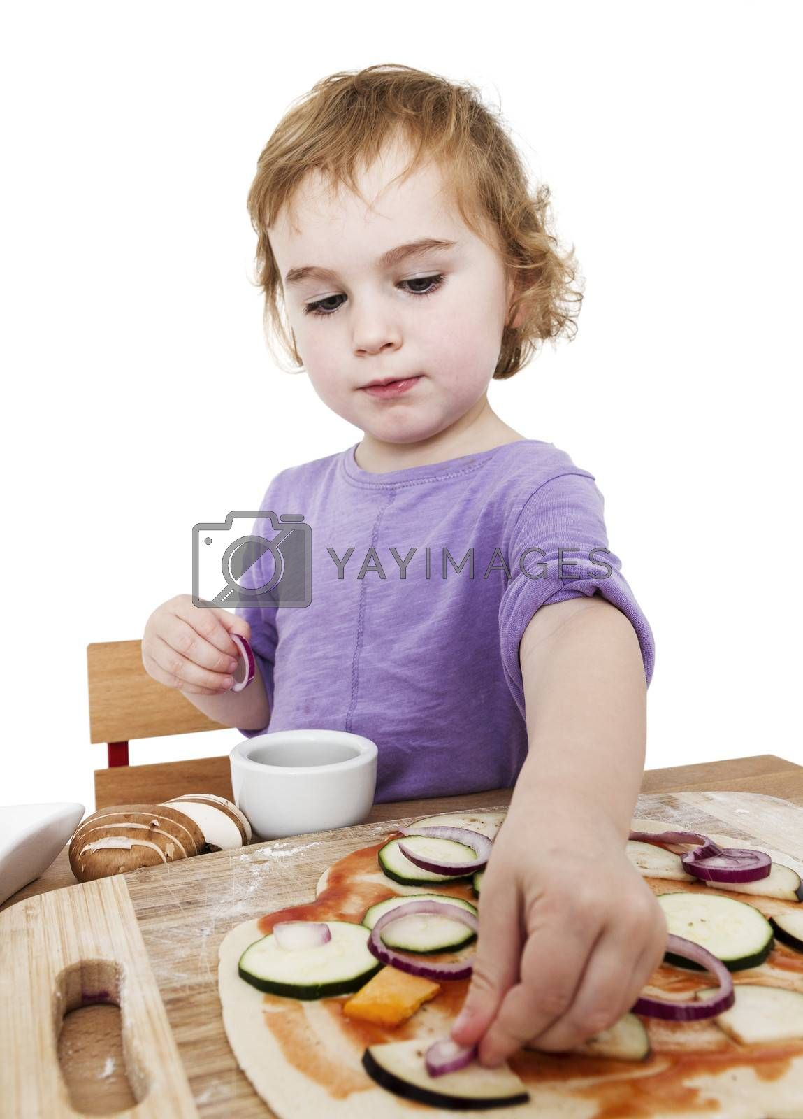 Royalty free image of homemade pizza by a cute little girl by gewoldi