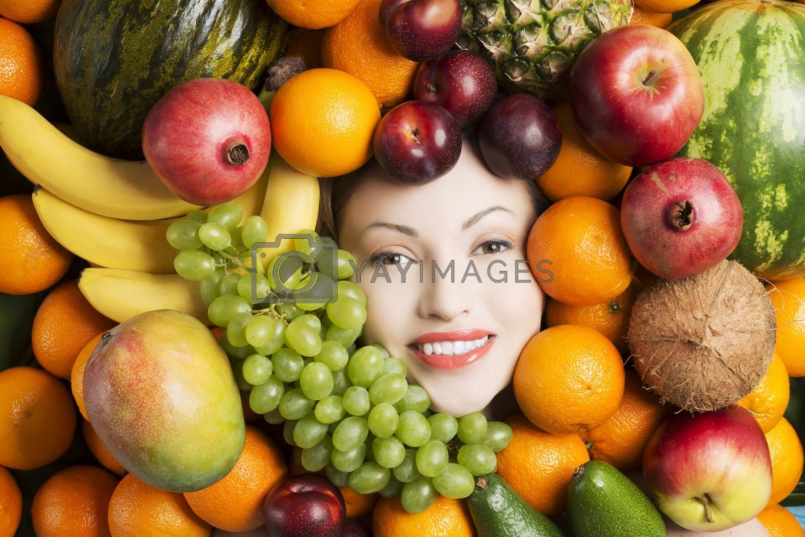 Woman face in fruits. by BDS