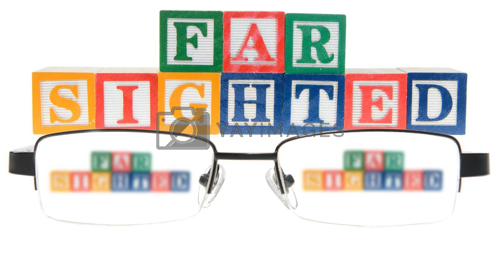 Letter blocks spelling far sighted with a pair of glasses. Isolated on a white background.