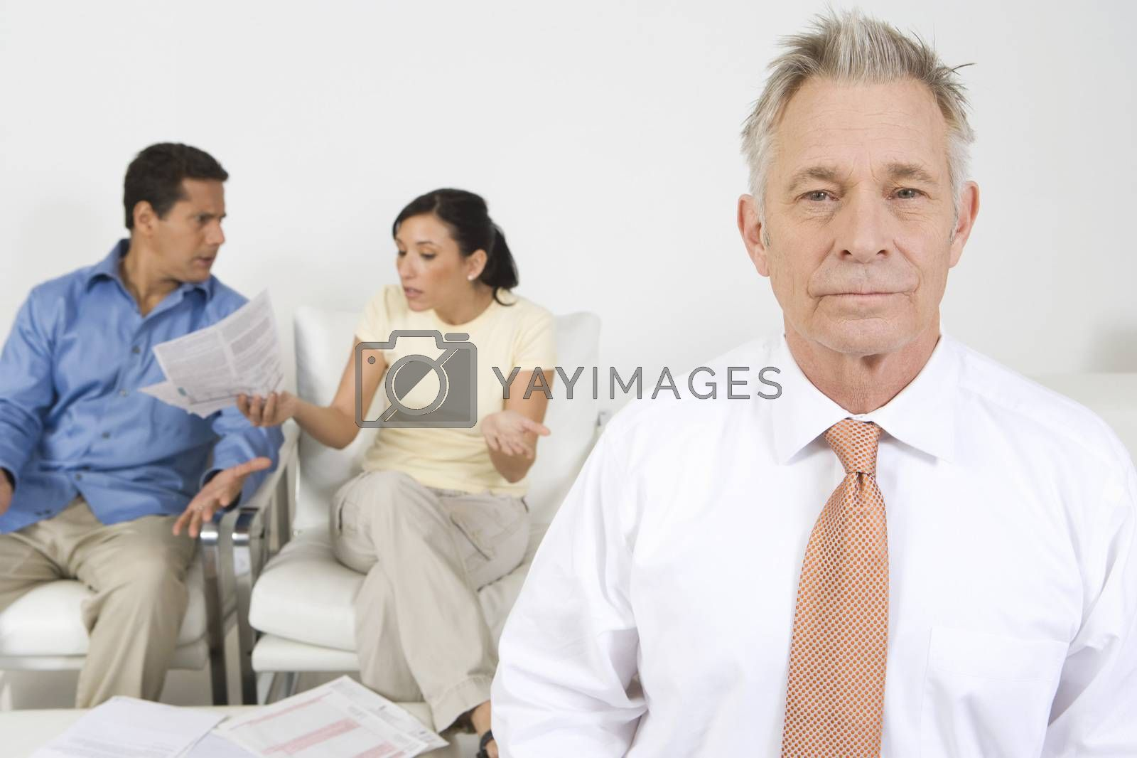 Businessman Assisting Couple