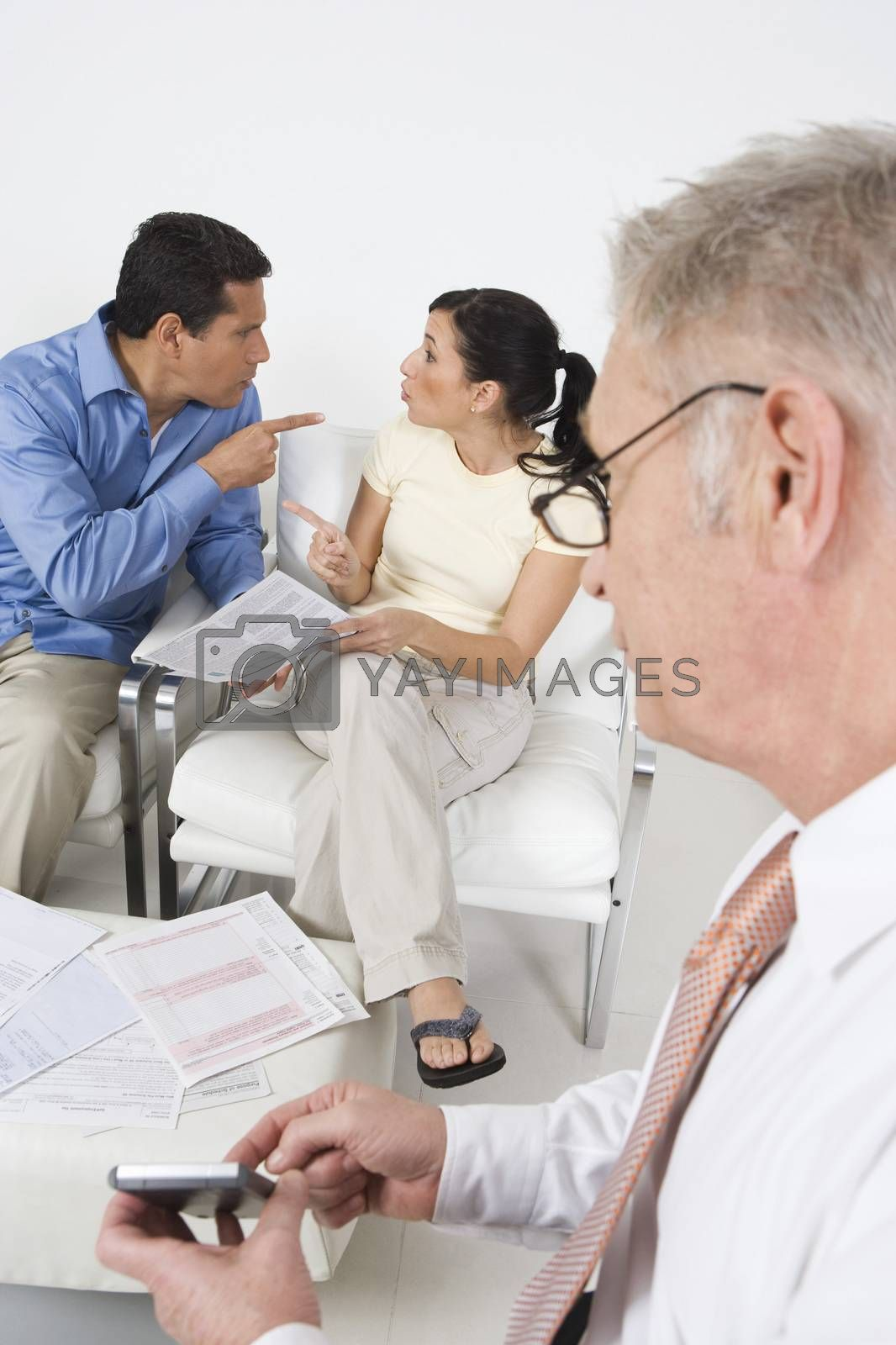 Businessman Assisting Angry Couple