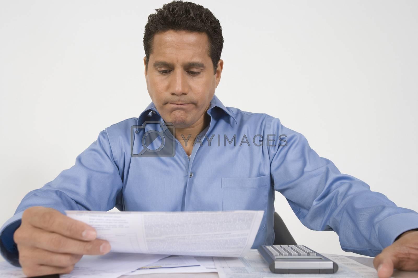 Man Reading Financial Document