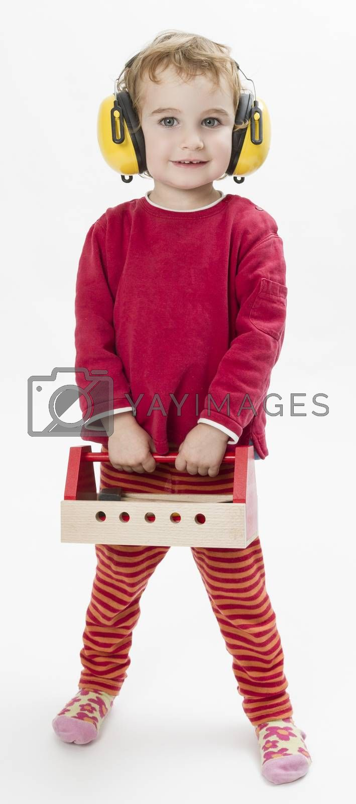 Royalty free image of child in red with toolbox and earmuffs by gewoldi
