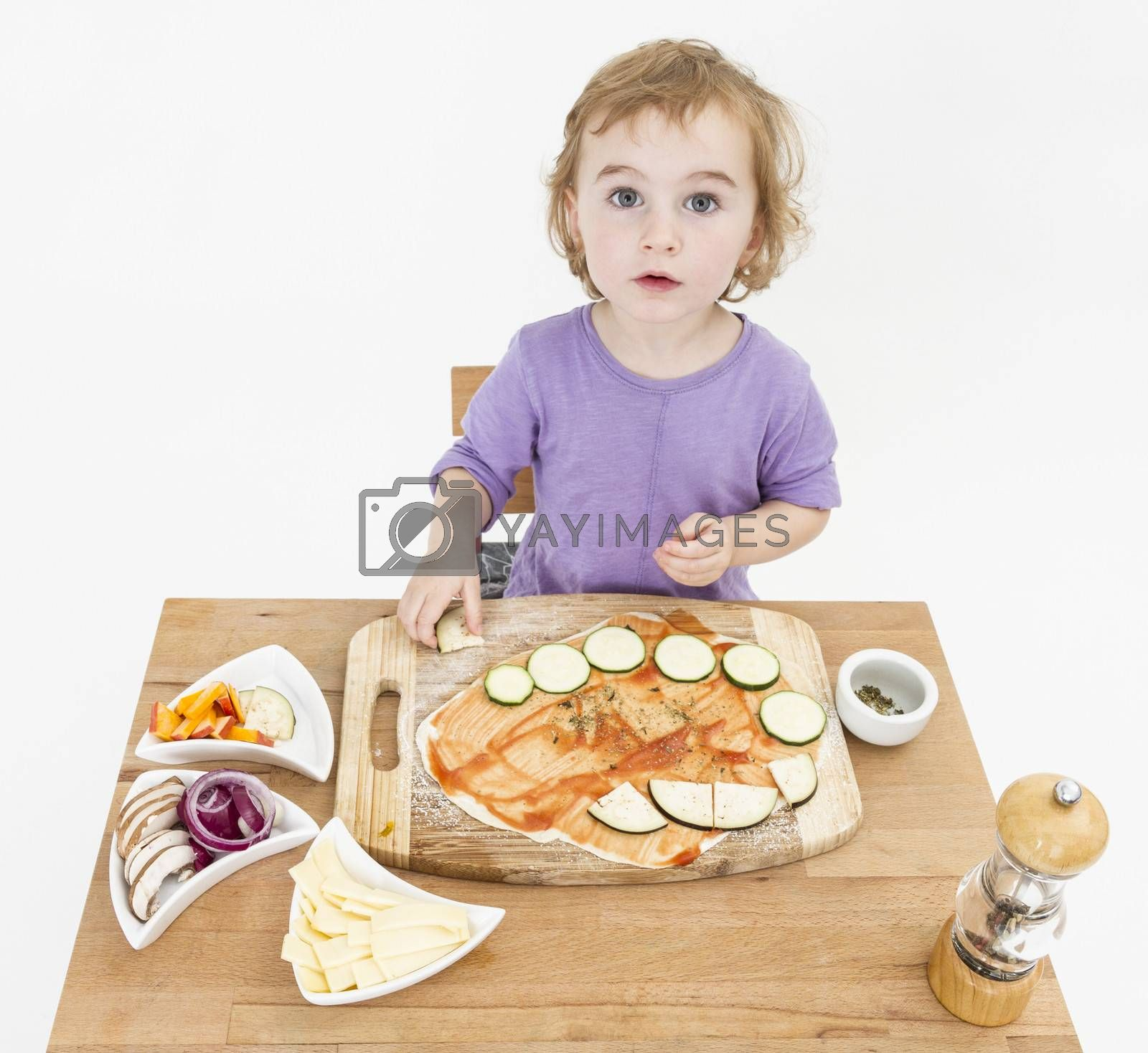 Royalty free image of child making pizza by gewoldi