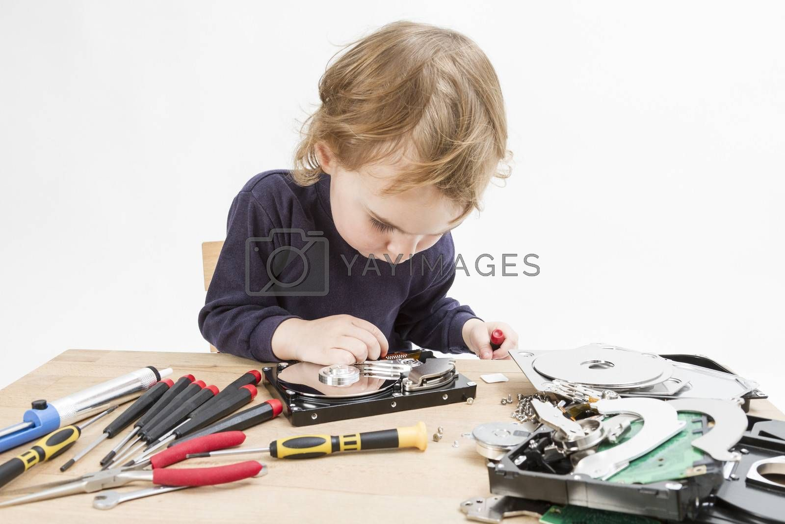 Royalty free image of child repairing hard disk drive by gewoldi