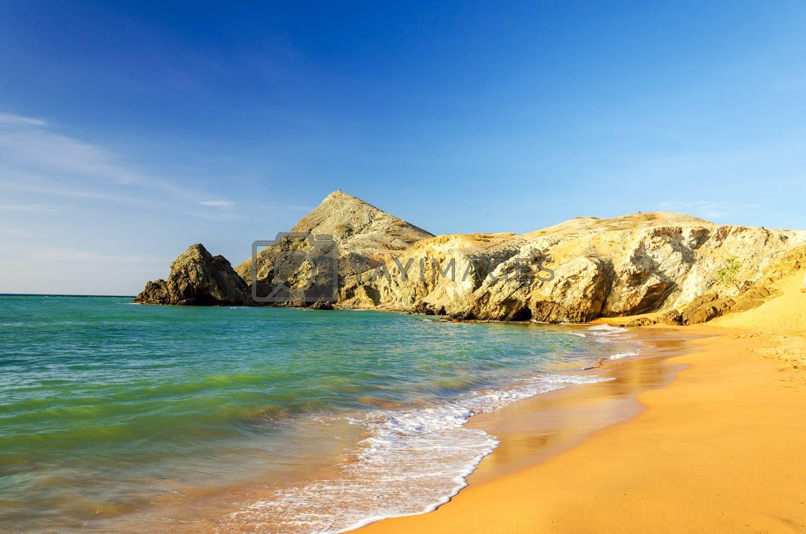 Clear blue water on a desert beach near Cabo de la Vela in La Guajira, Colombia