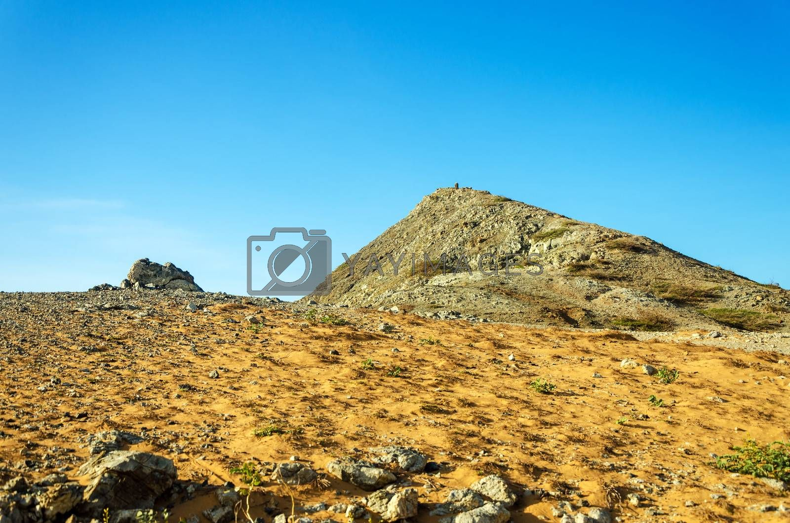 Pilon de Azucar hill rising above a dry barren desert in La Guajira, Colombia