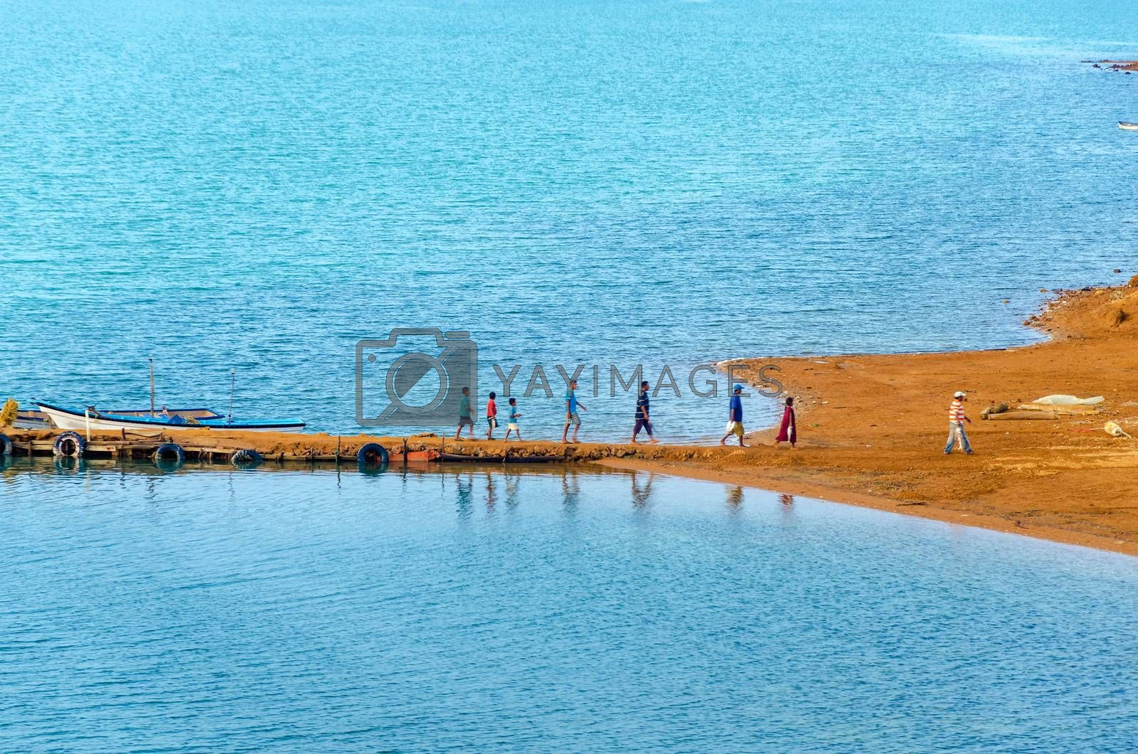 Group of people disembarking from small boats in La Guajira, Colombia