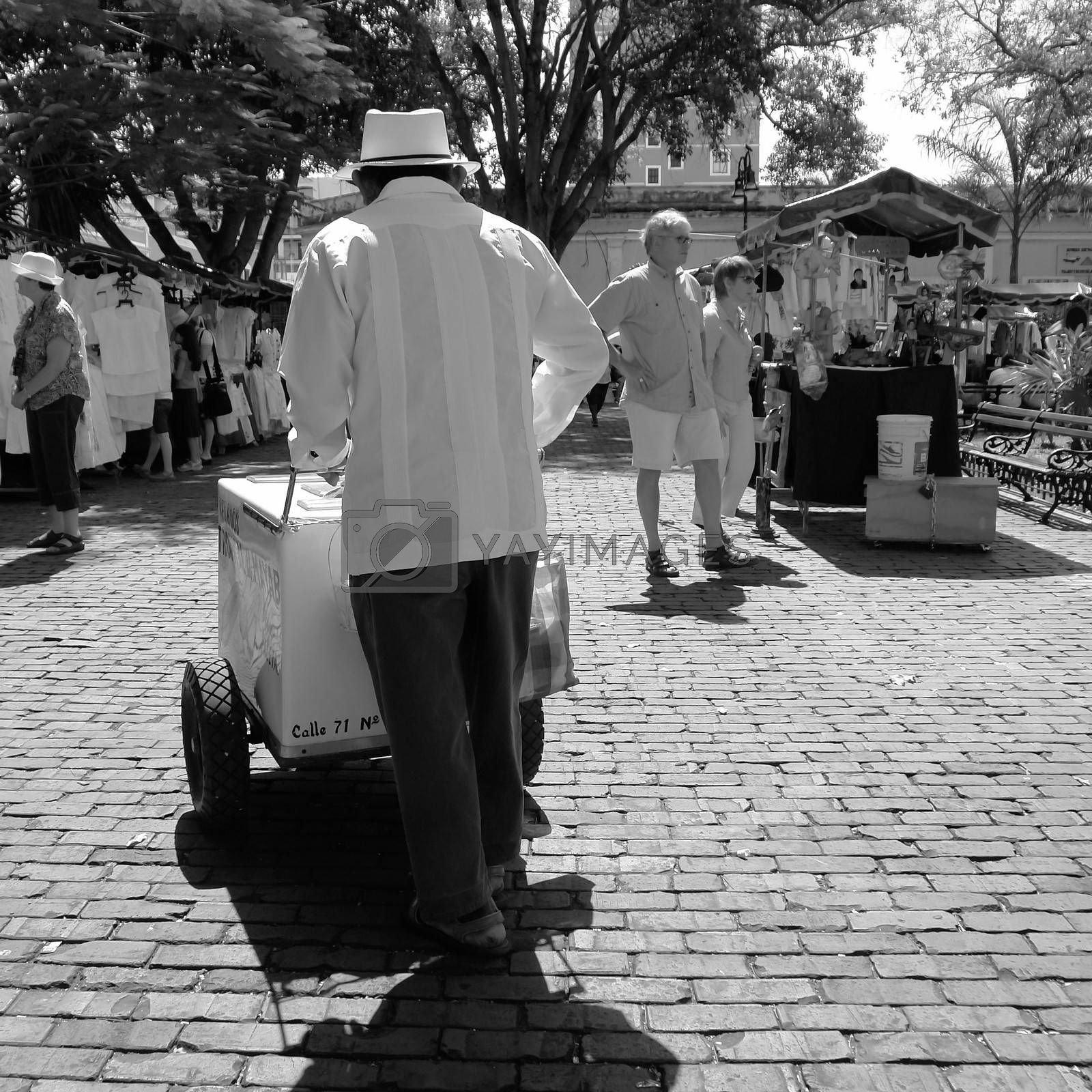 Yucatan street vendor wearing the typical guayabera and sombrero