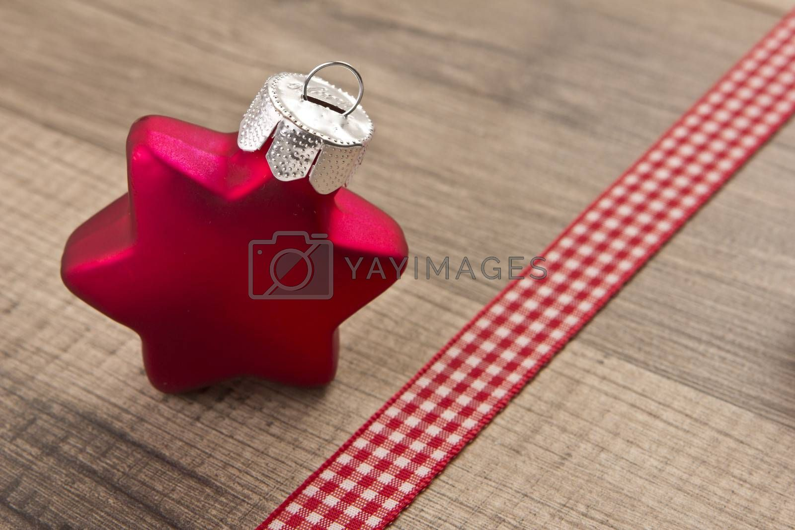 Christmas decoration with wood background, Christmas balls as star red with ribbon