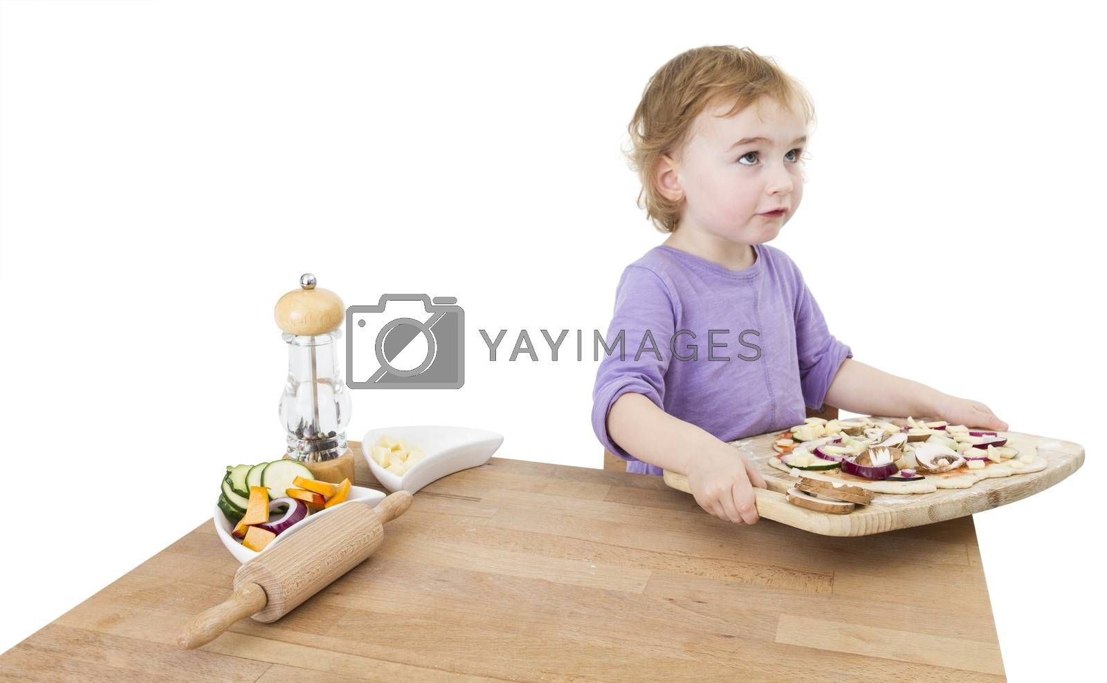 Royalty free image of child with home made pizza by gewoldi