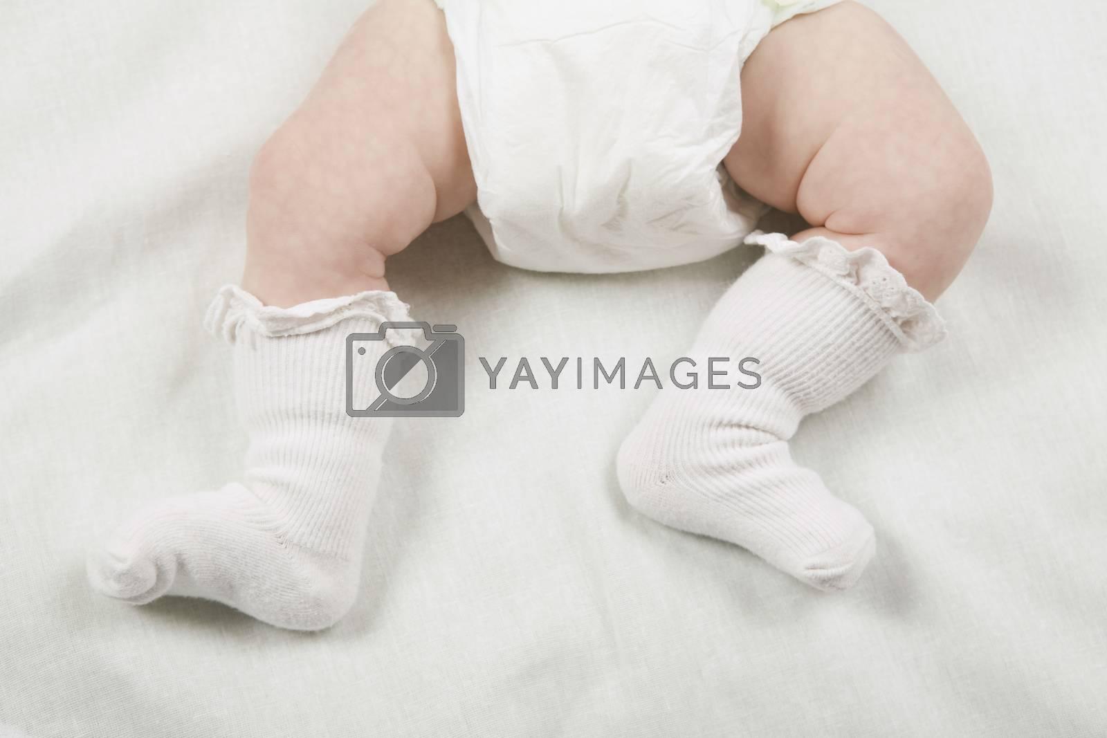 Socks on babies feet close-up by moodboard