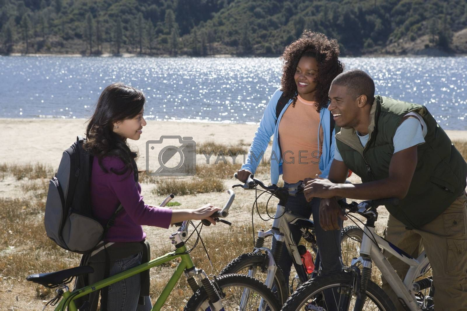 Friends With Mountain Bikes By The Lake
