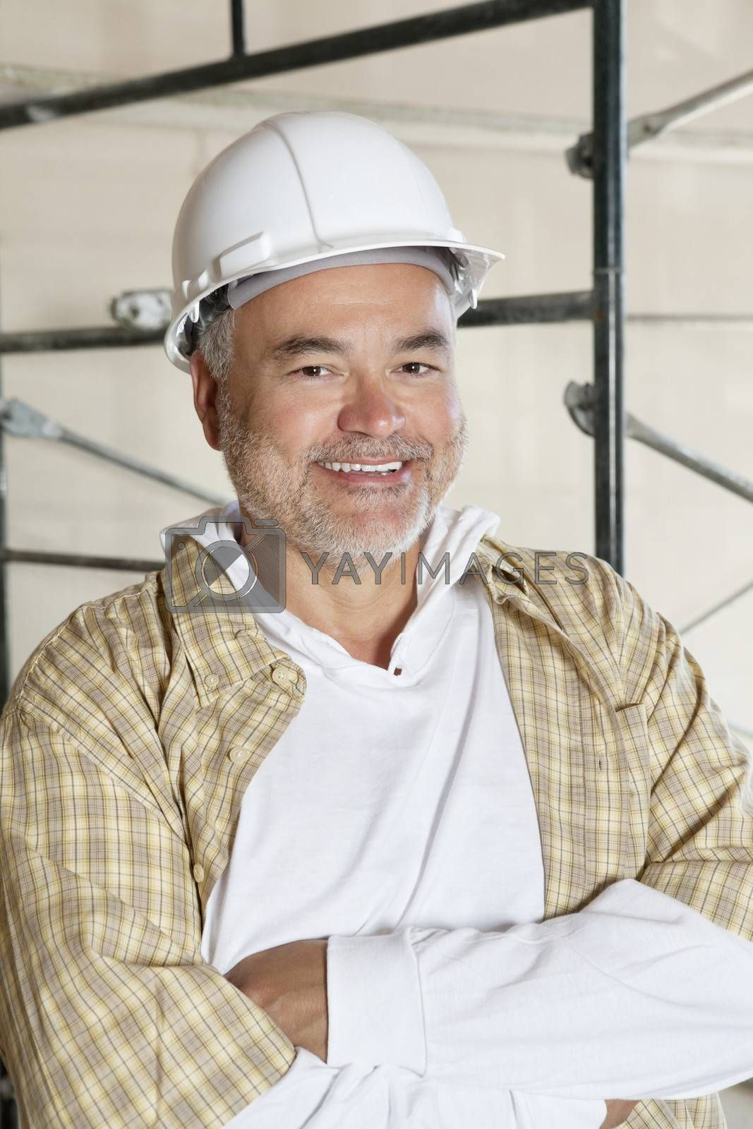 Portrait of happy architect with arms crossed
