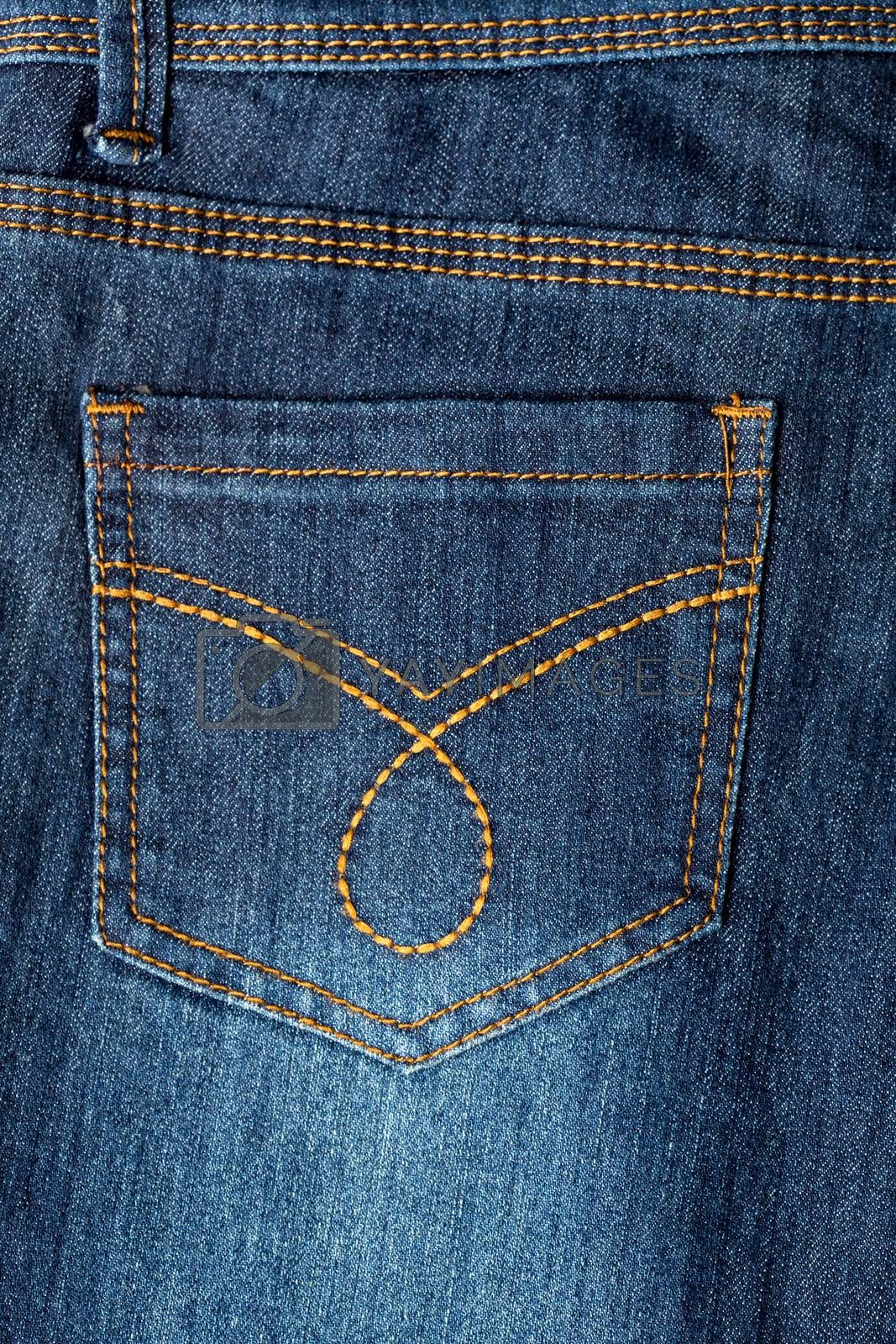 Closeup image of a denim jeans, back pocket
