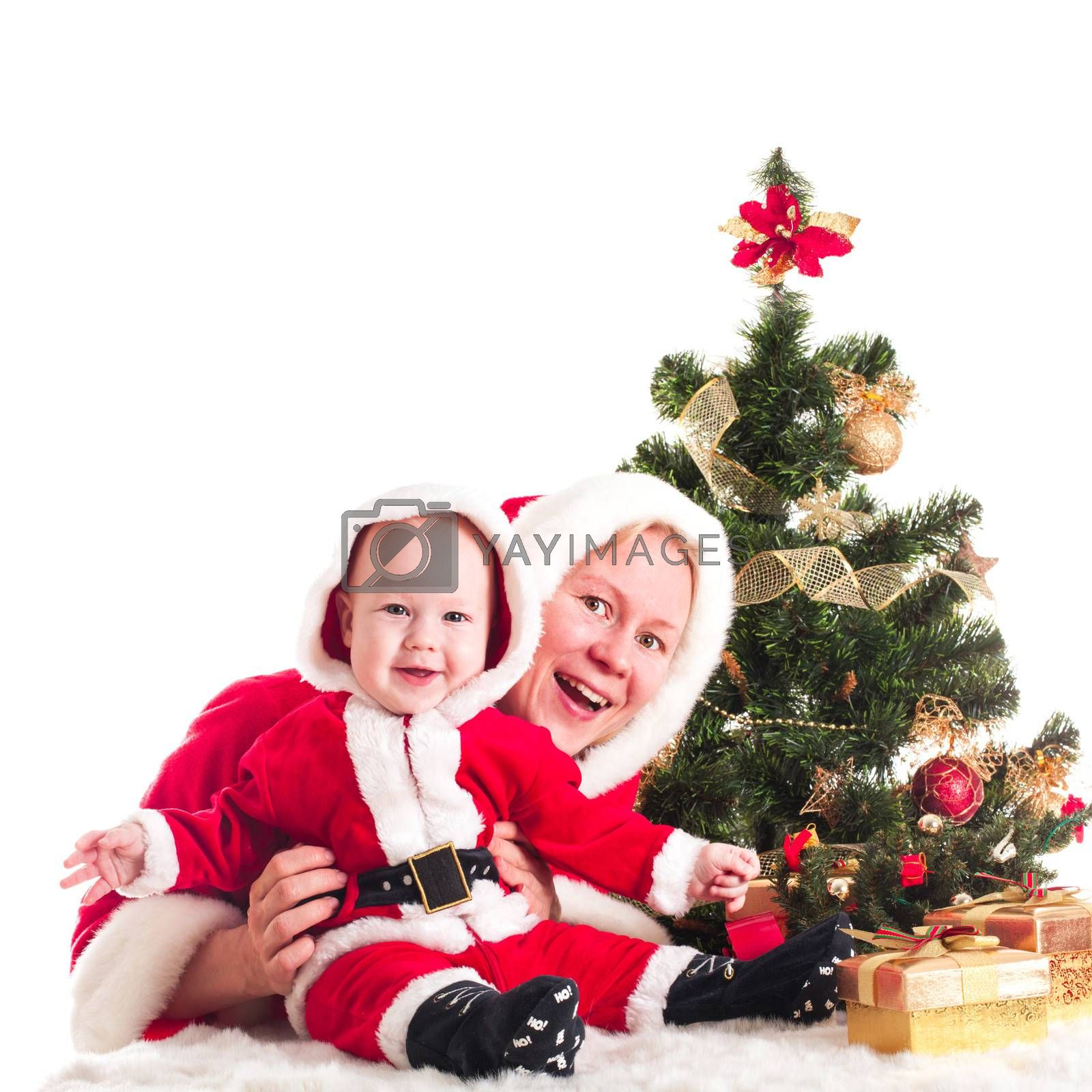 Christmas baby and mom under the fir tree isolated