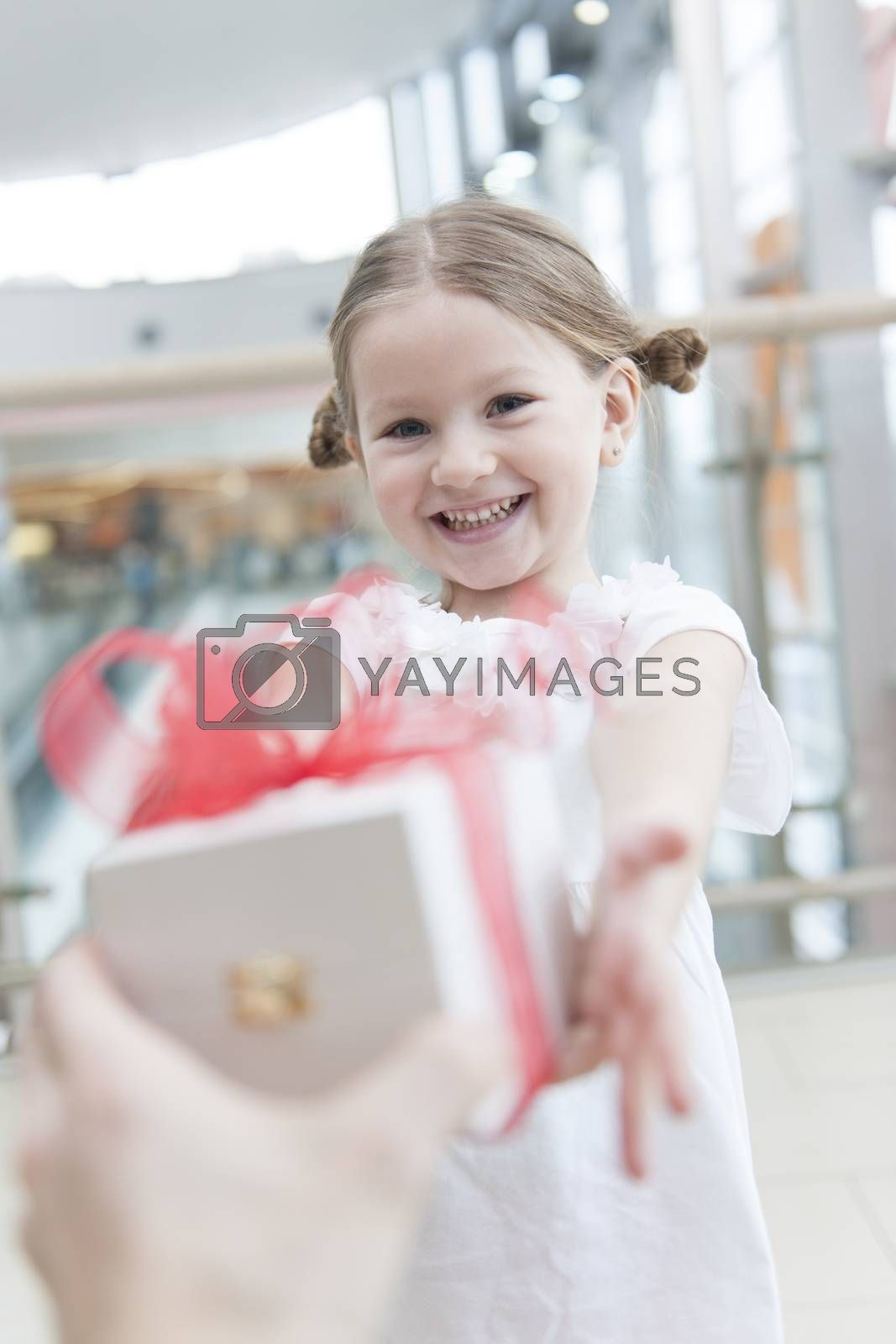 Young girl being giving a present