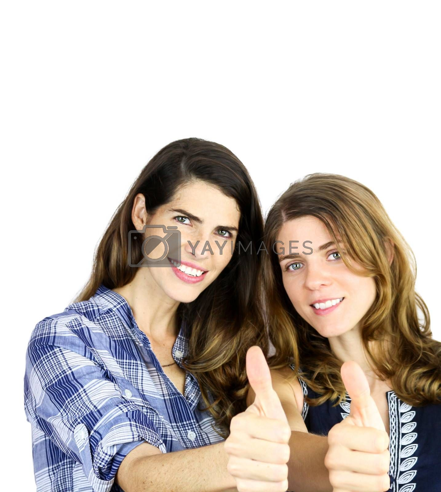 two beautiful young women showing thumbs up