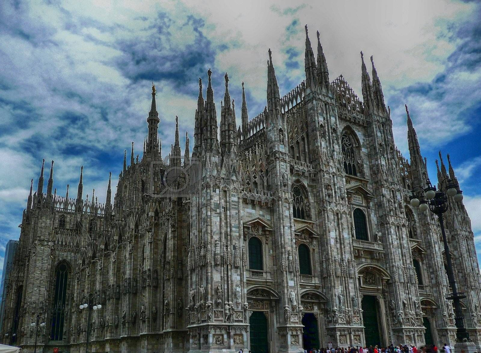 Milan Cathedral against a scenic cloudy sky, Italy