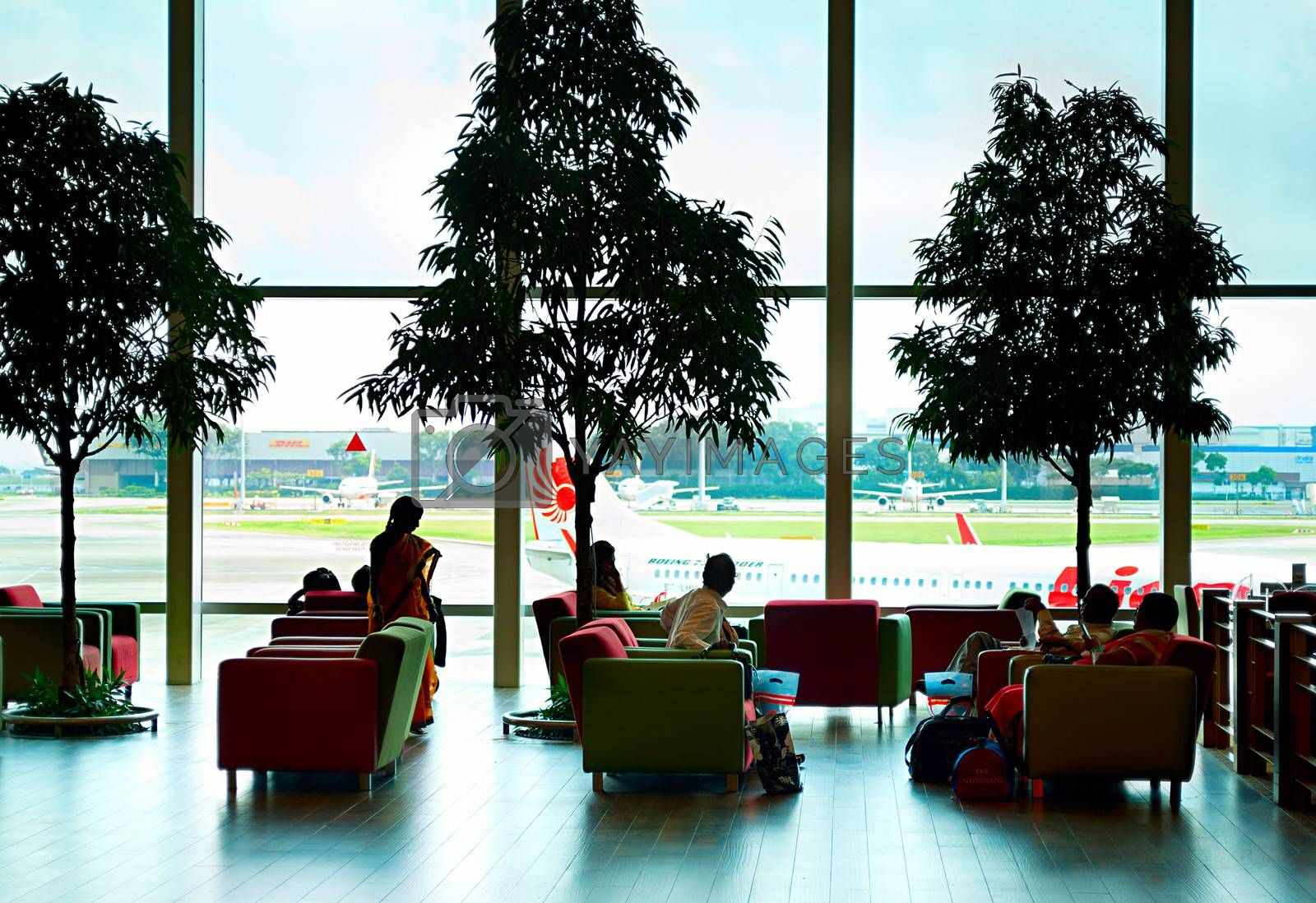 Singapore, Republic of Singapore - March 05, 2013: People at a lounge at Changi International Airport. Changi Airport serves more than 100 airlines operating 6,100 weekly flights connecting Singapore to over 220 cities