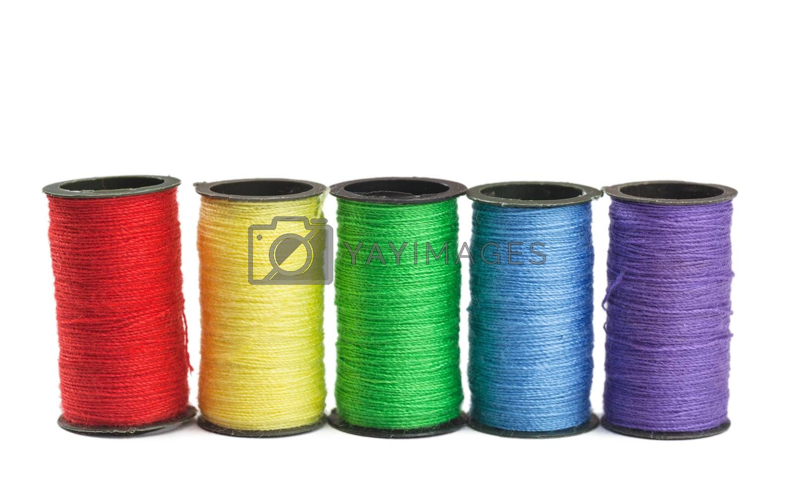 Colorful spools with green, blue, yellow and red threads