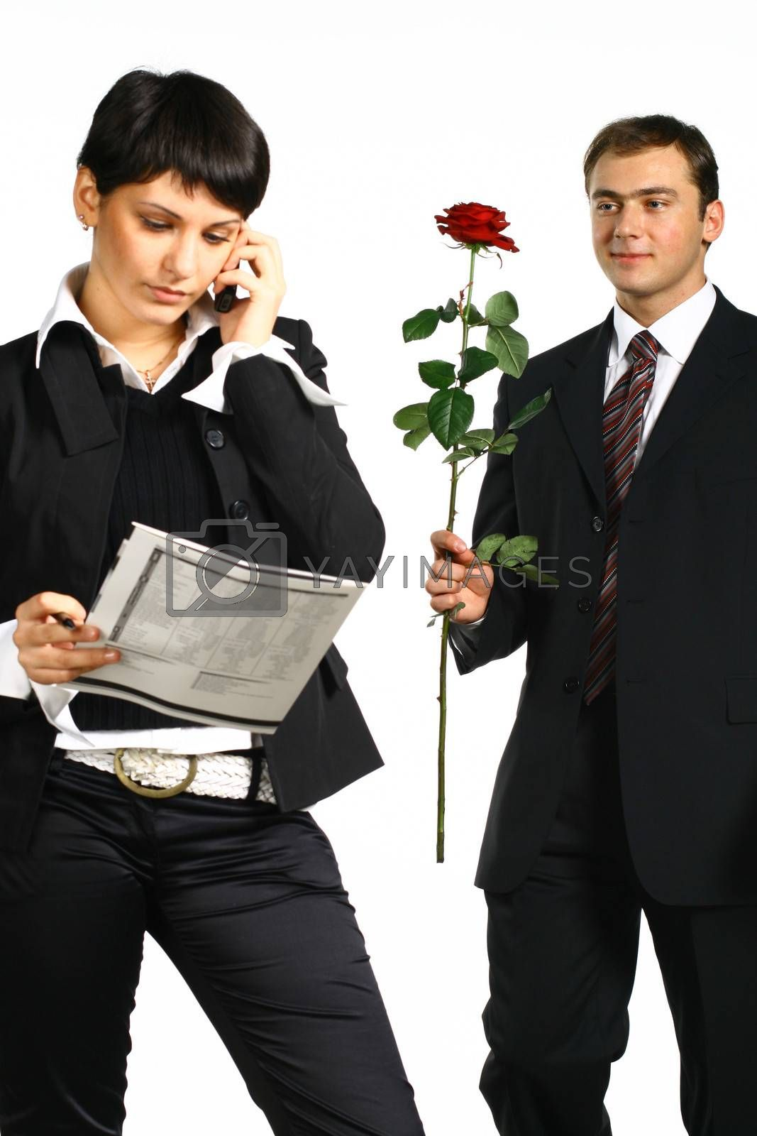 The business girl works and director tries to present it a flower