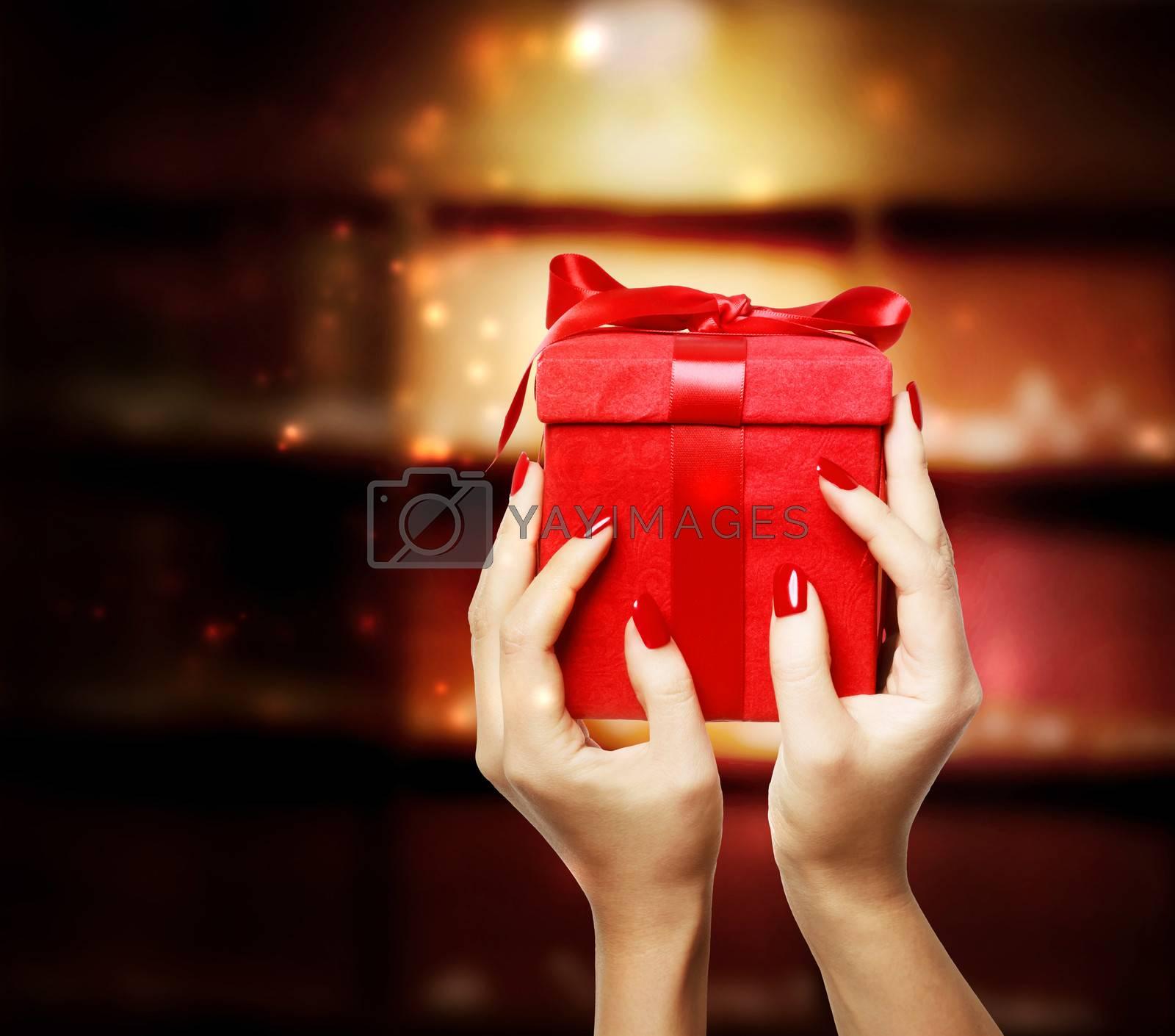 Royalty free image of Woman Displaying Red Gift Box by melpomene