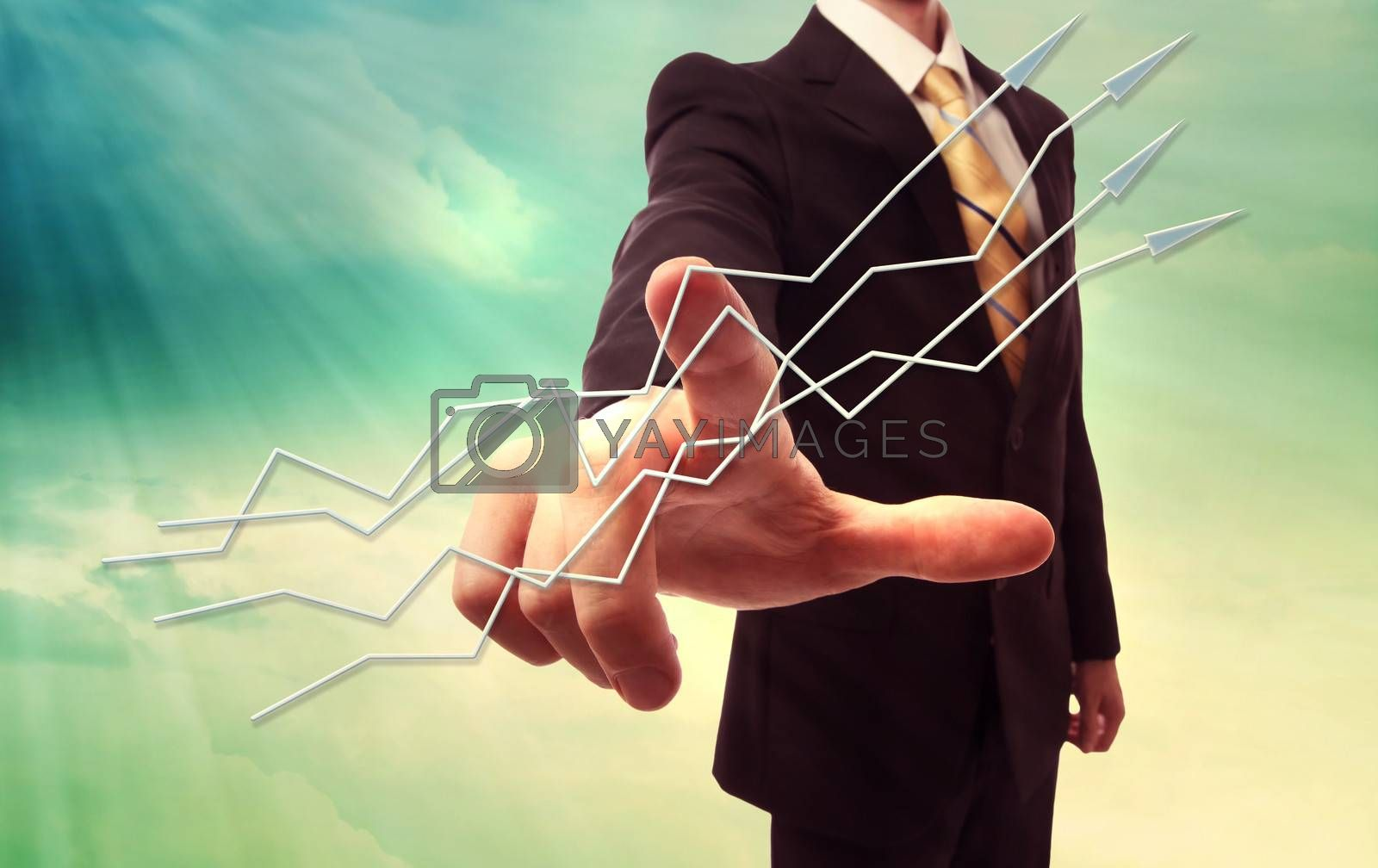 Royalty free image of Businessman pointing arrows by melpomene